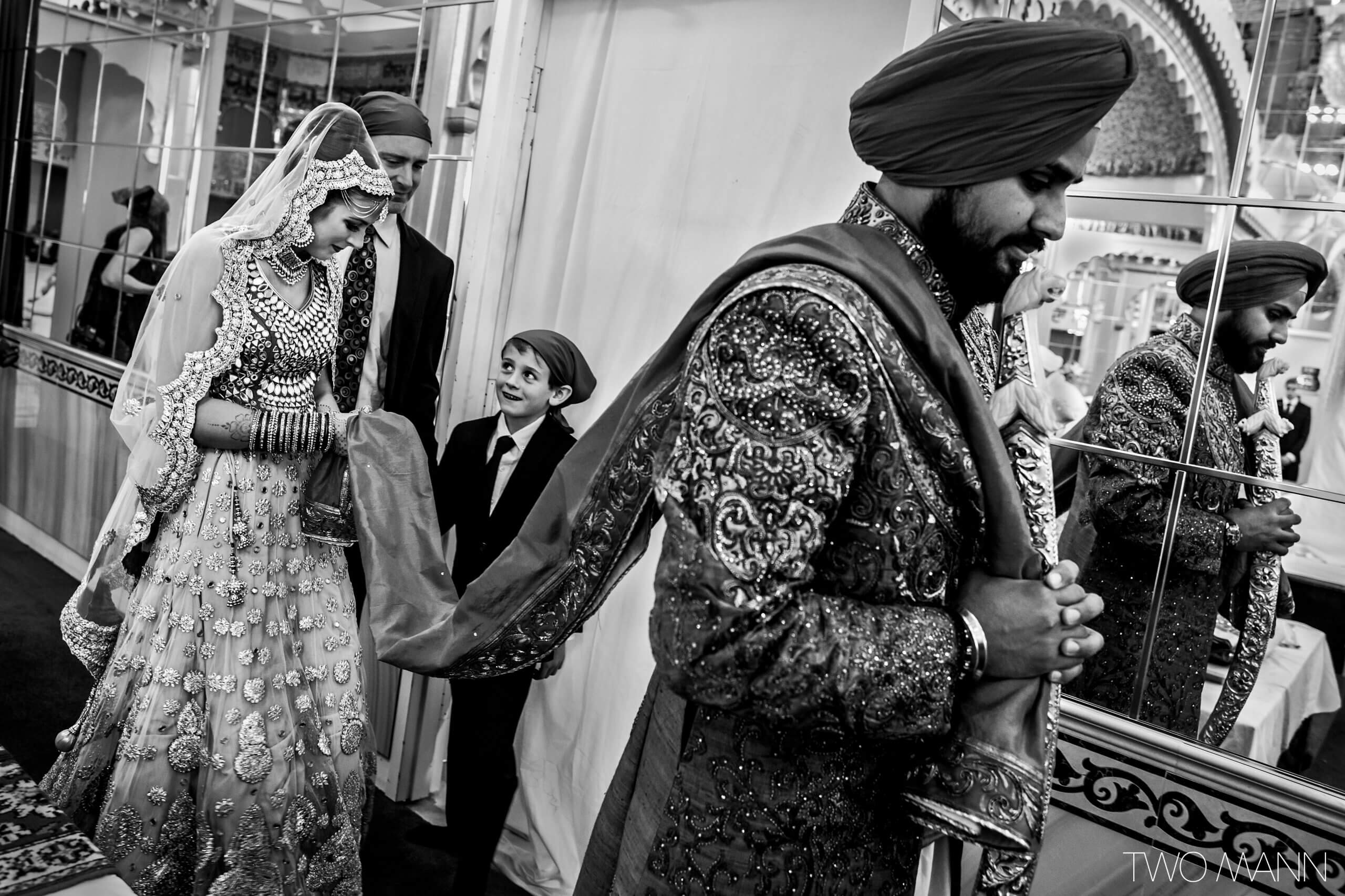 a groom leads his bride at an indian wedding ceremony