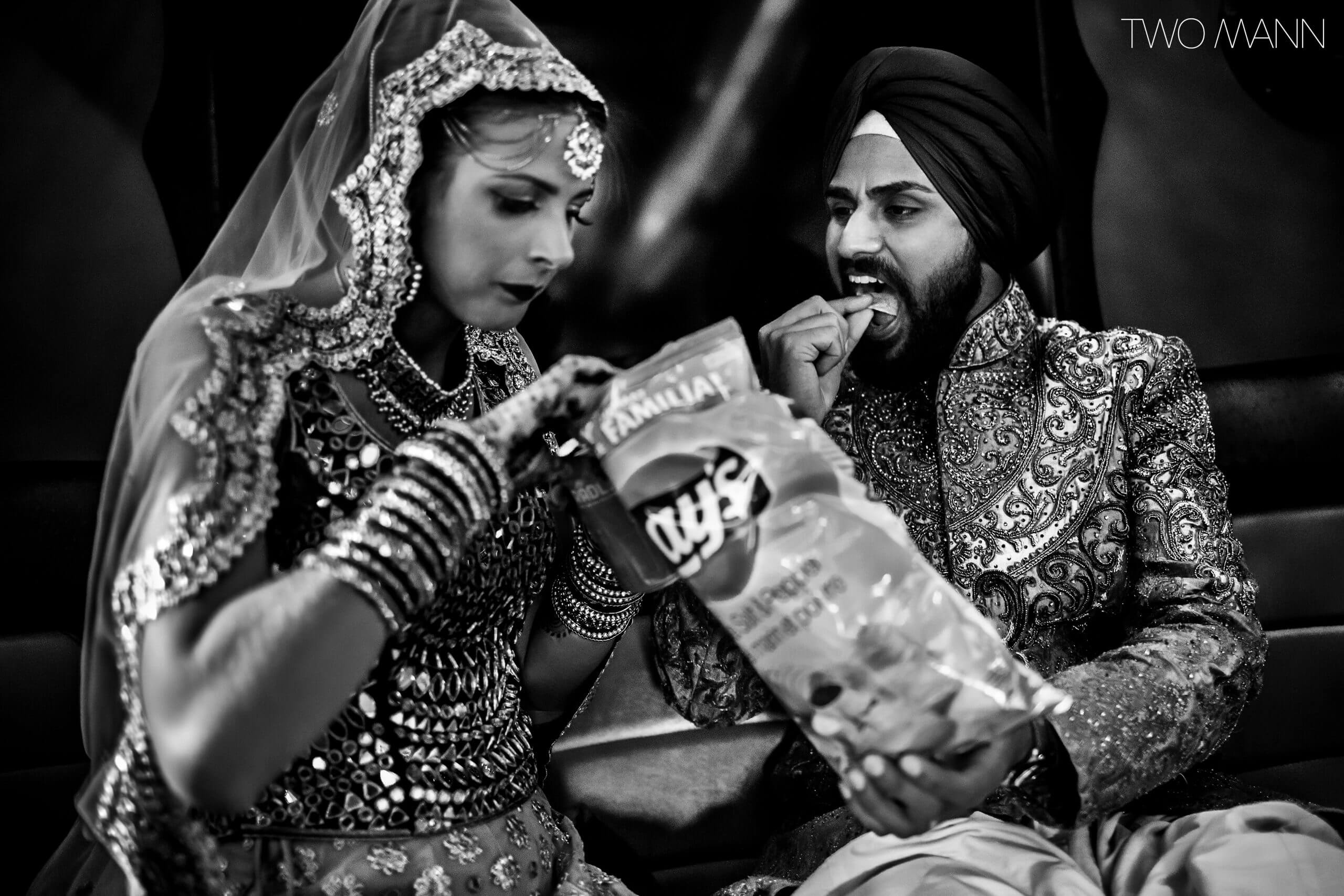 new indian couple having a snack
