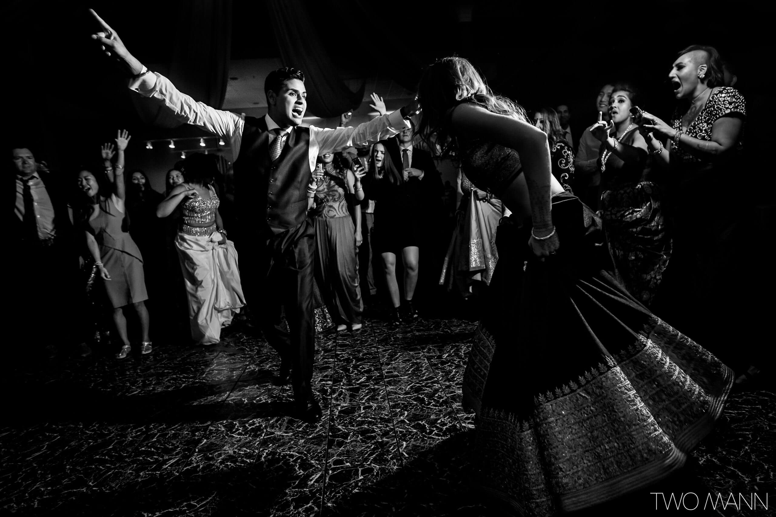 guests cheering at bride and groom's wedding dance