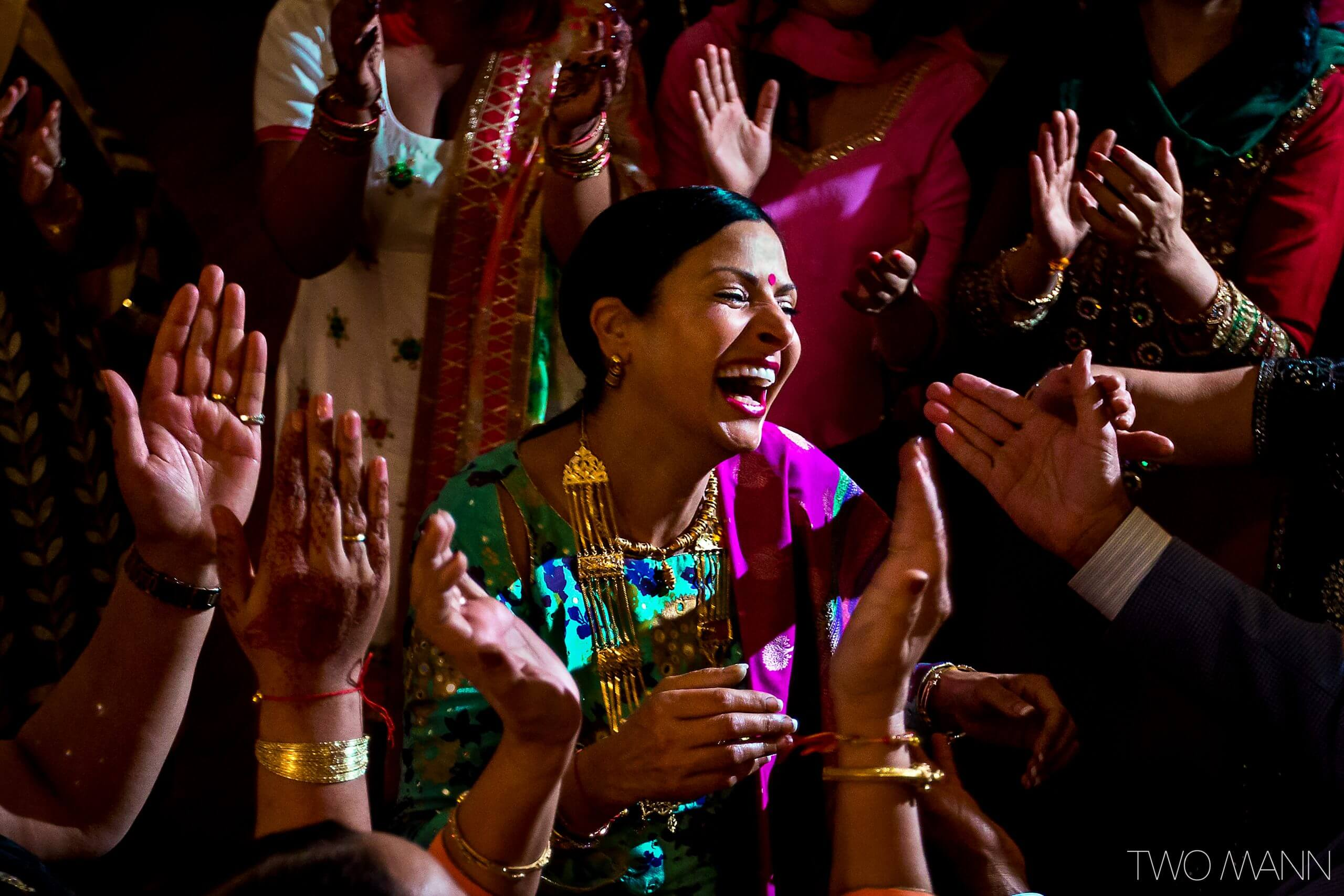 guests welcoming a lady at an Indian wedding ceremony