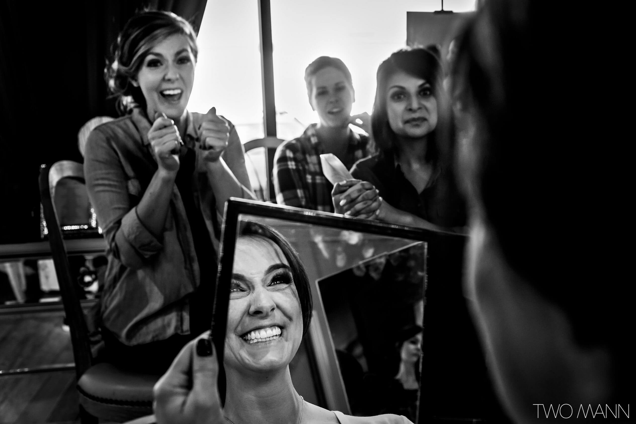 a bride looking at her makeup with satisfaction