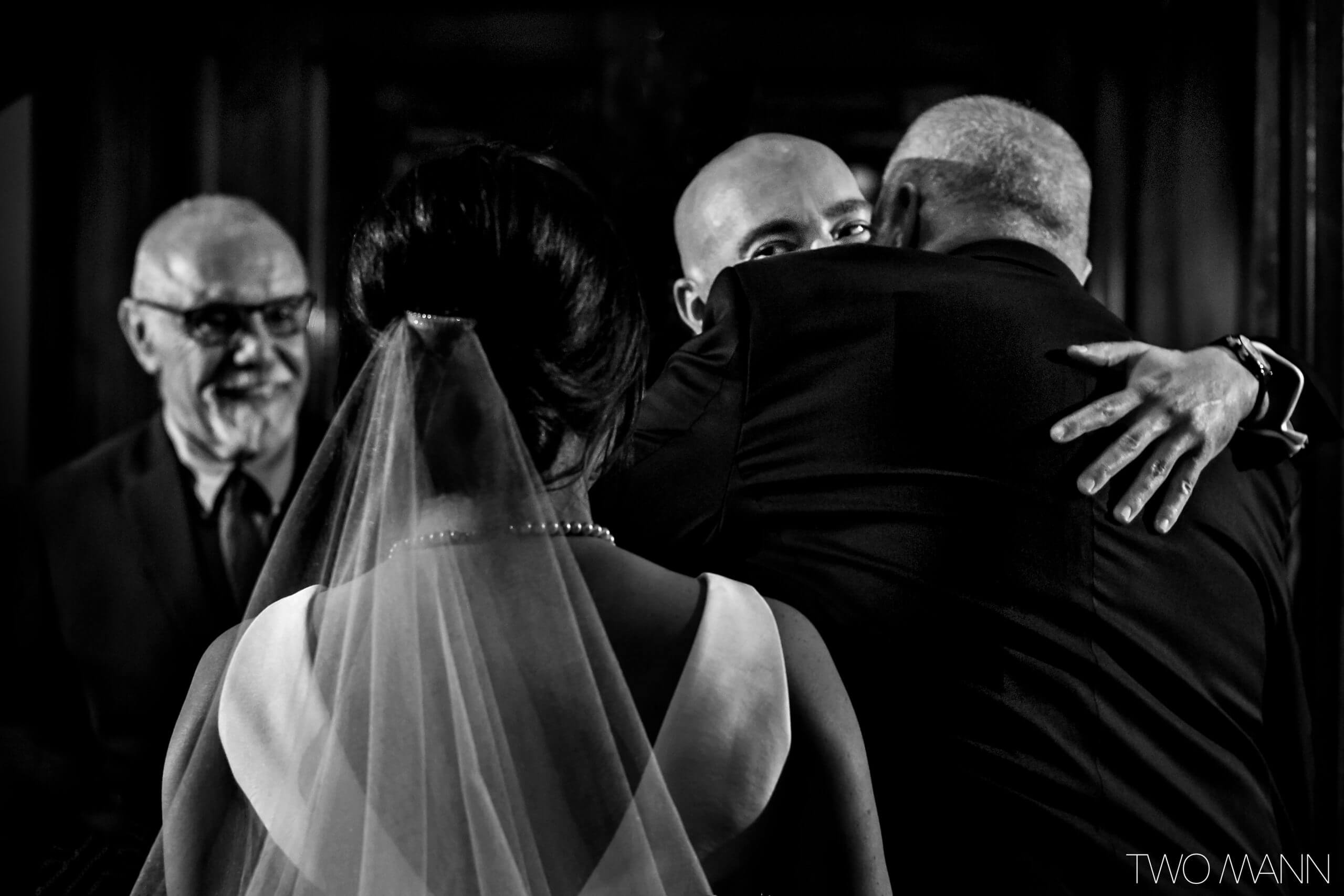 bride's father hugging with groom