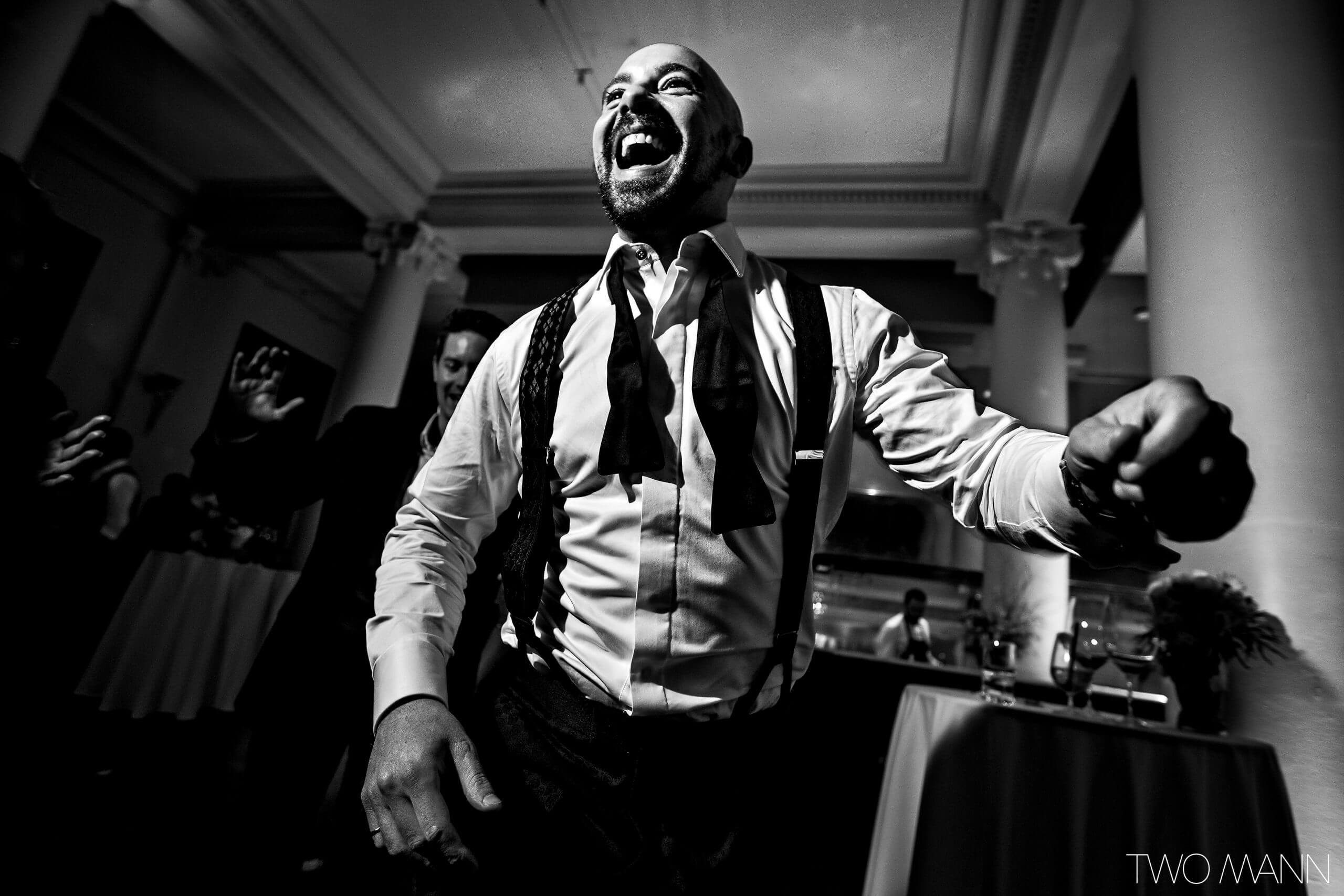 a happy and relax groom at the wedding reception at teatro calgary