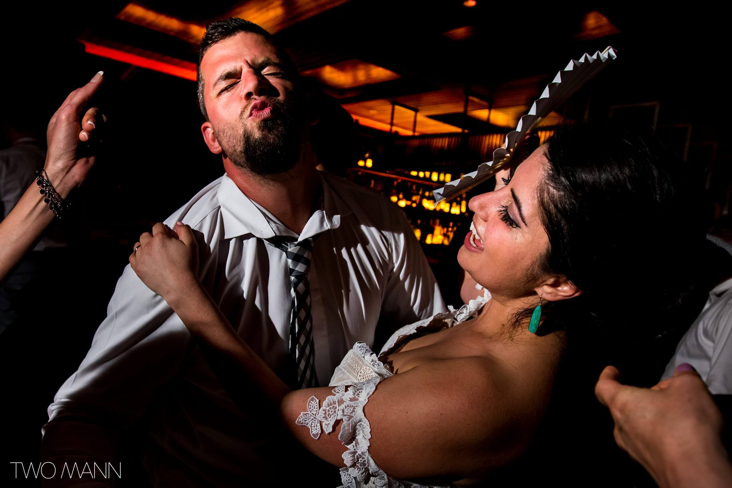 bride and groom enjoying exciting moment of wedding dance