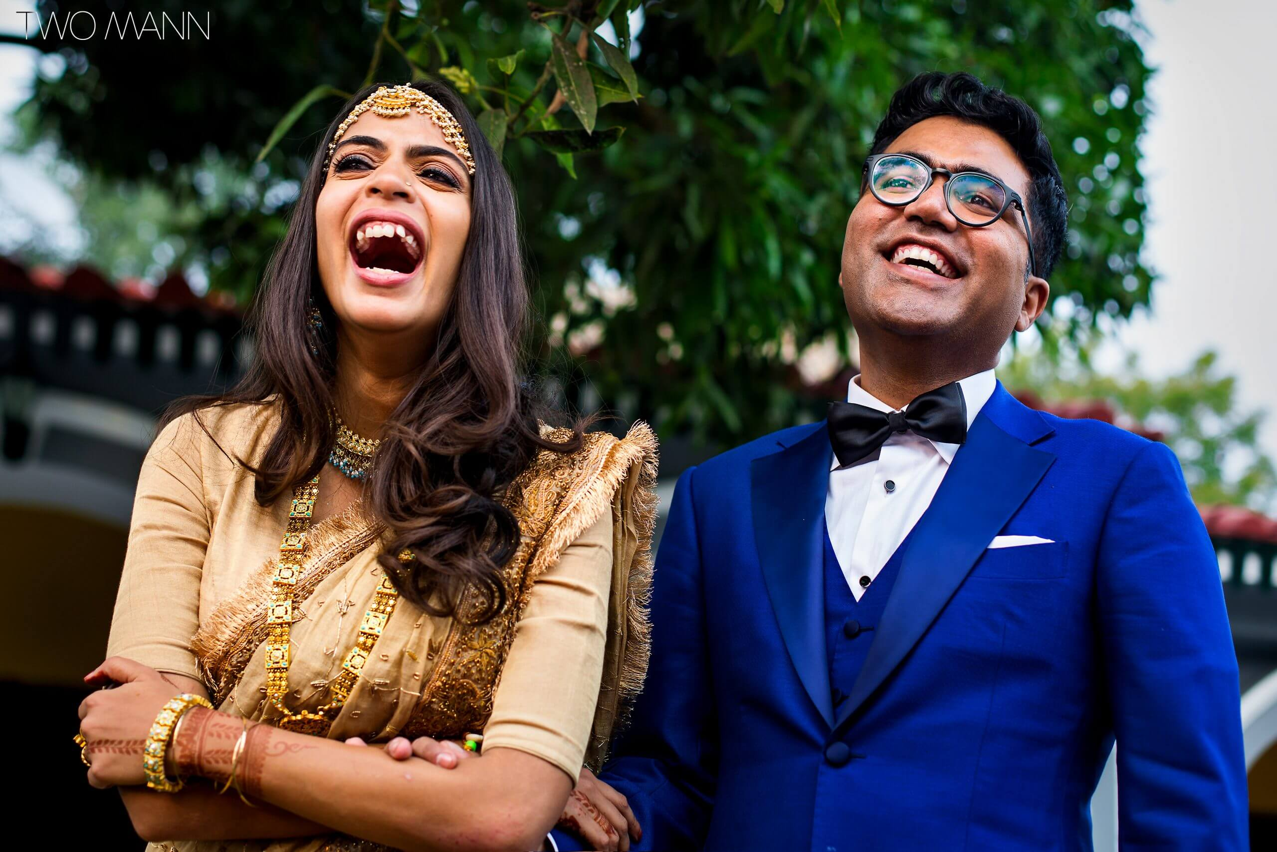 indian bride and groom laughing with friends