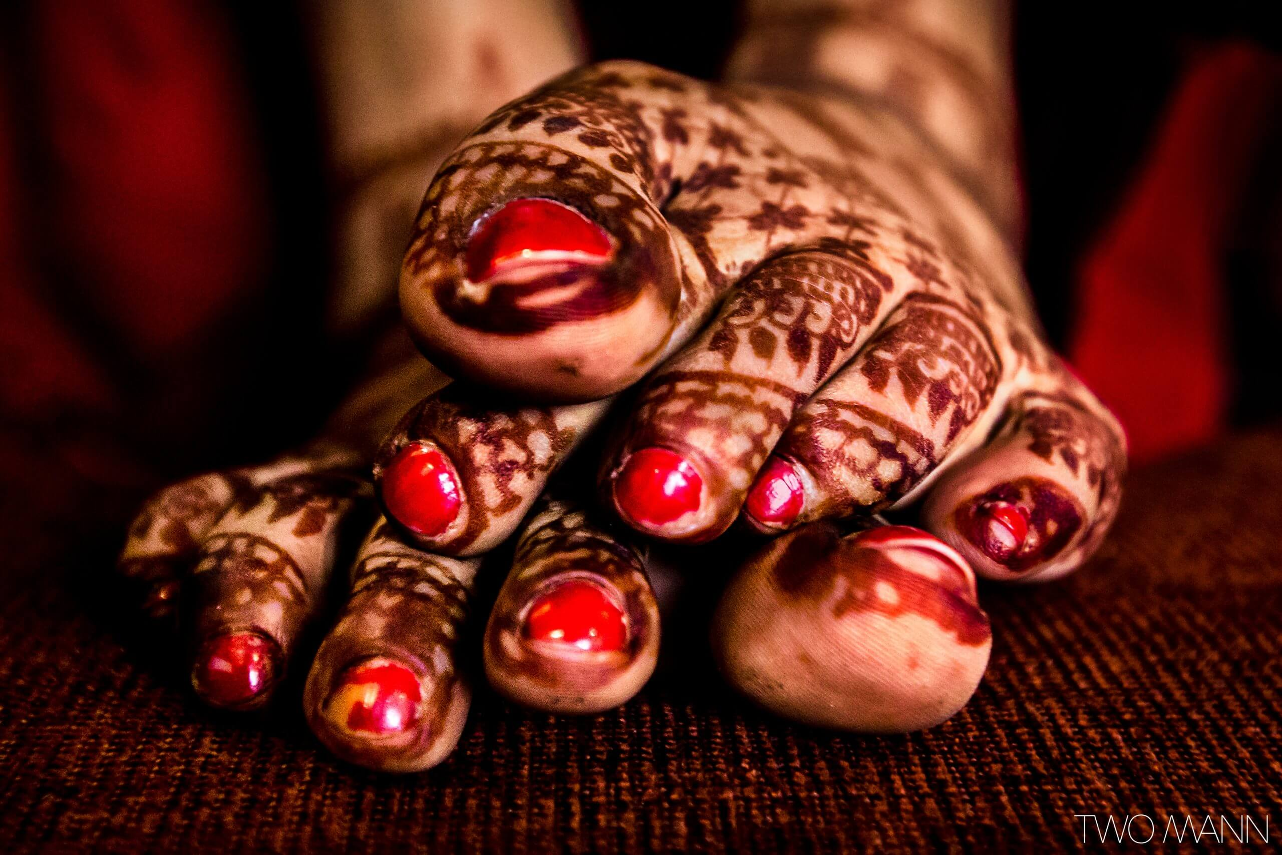 indian bride with mehndi design on her feet
