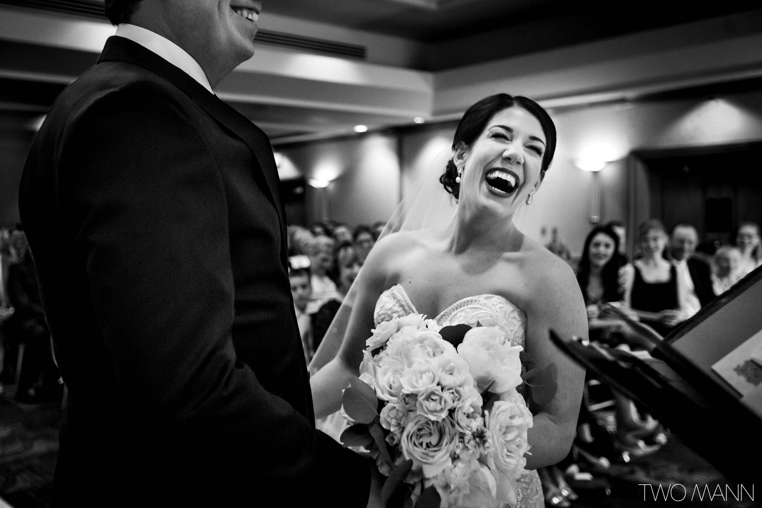 bride laughing during wedding ceremony