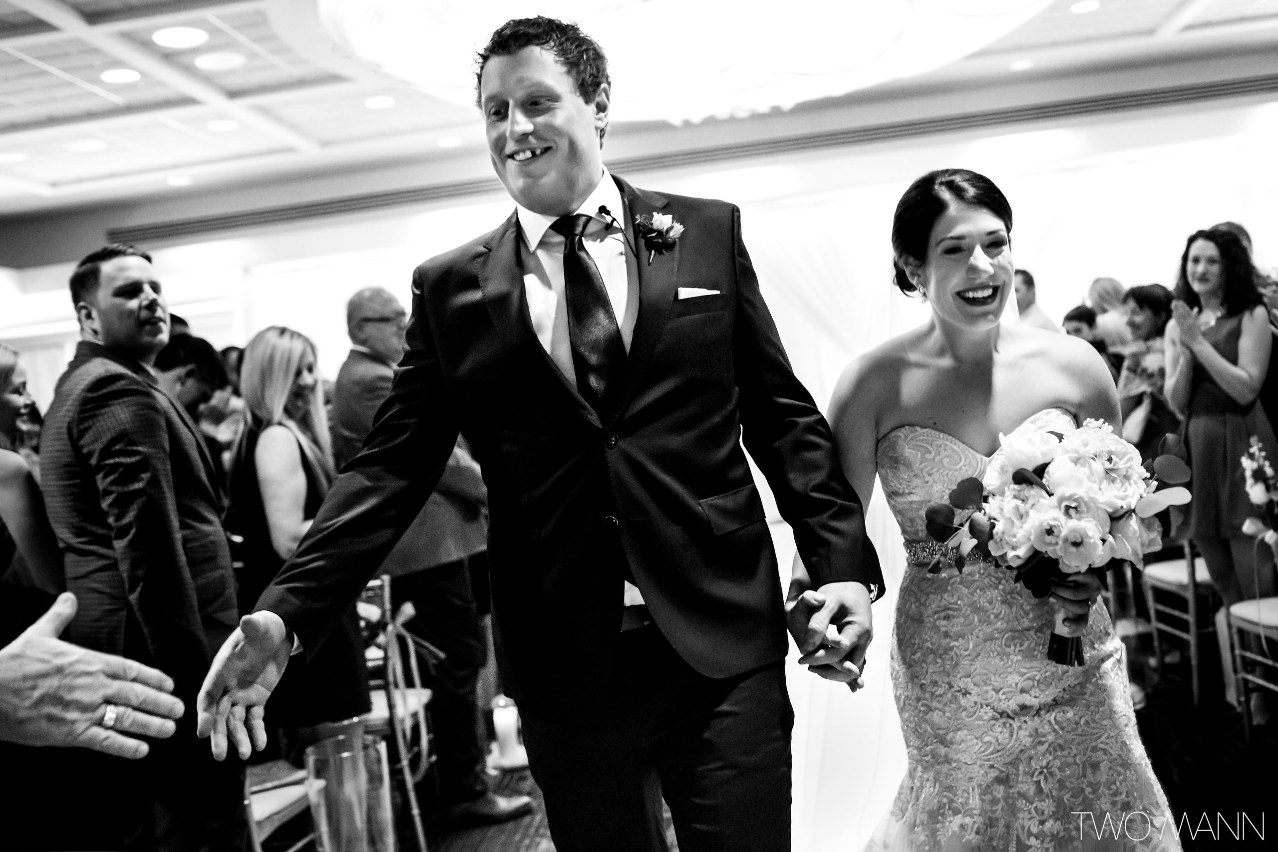 bride and groom walking down the isle after ceremony