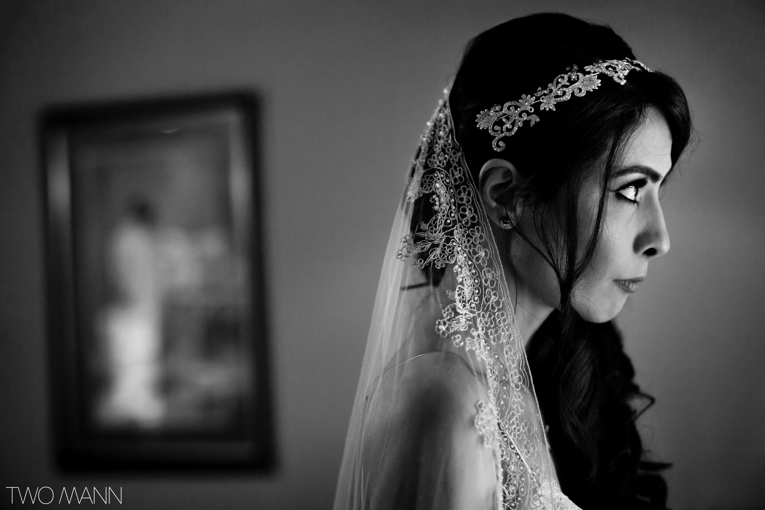 Close up of bride in veil staring forwards intently