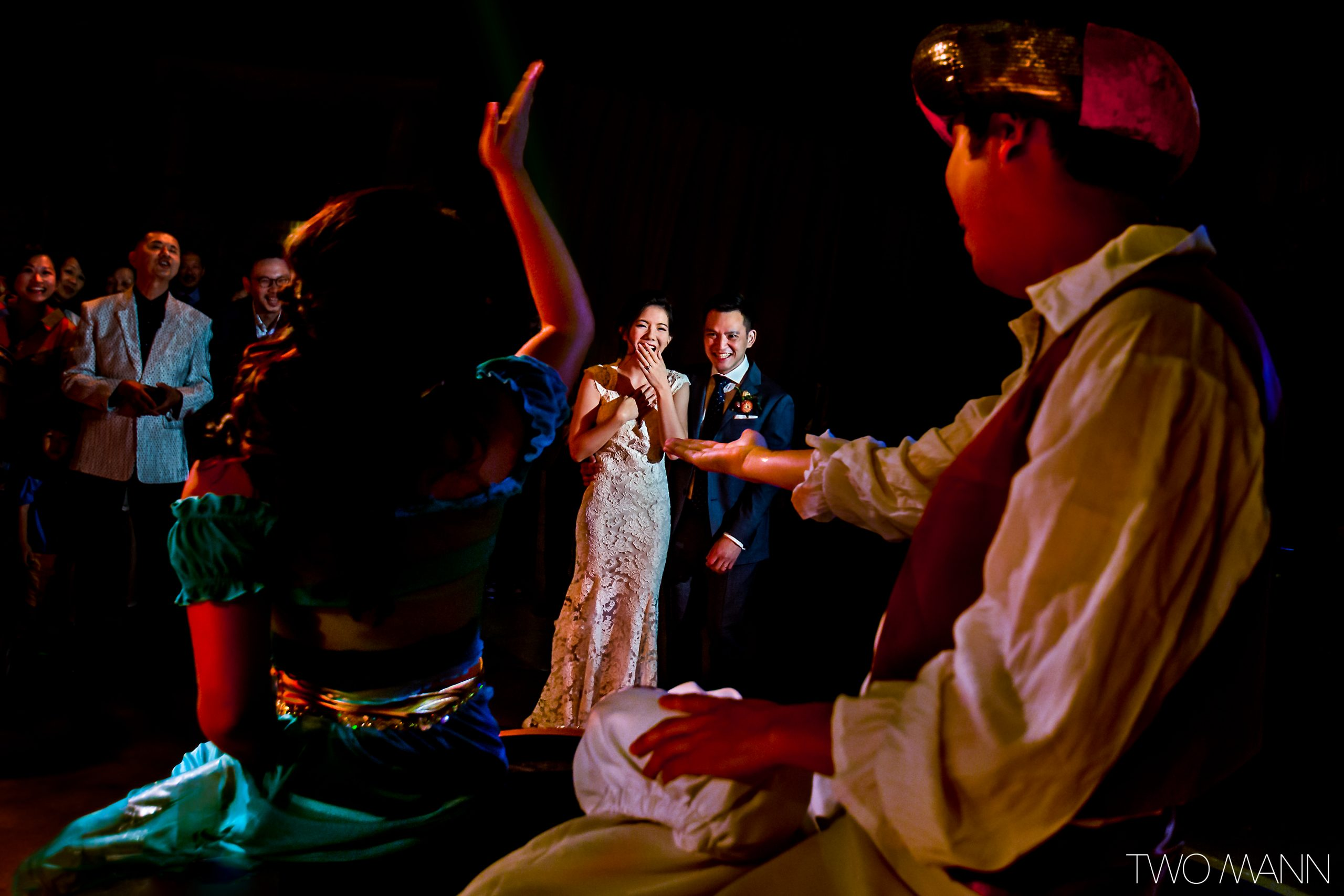 aladdin performance at wedding reception with bride and groom laughing