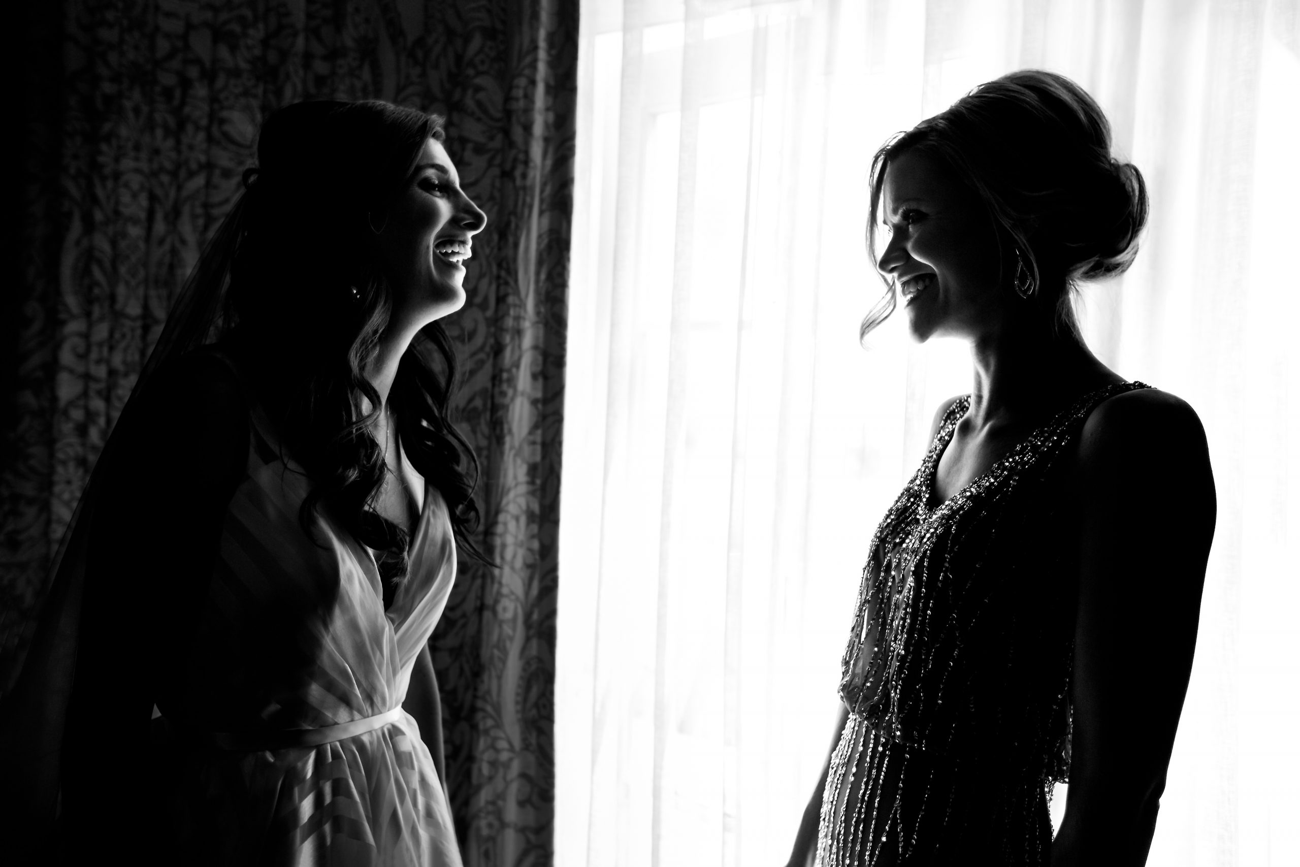 Bride and her friend smile together