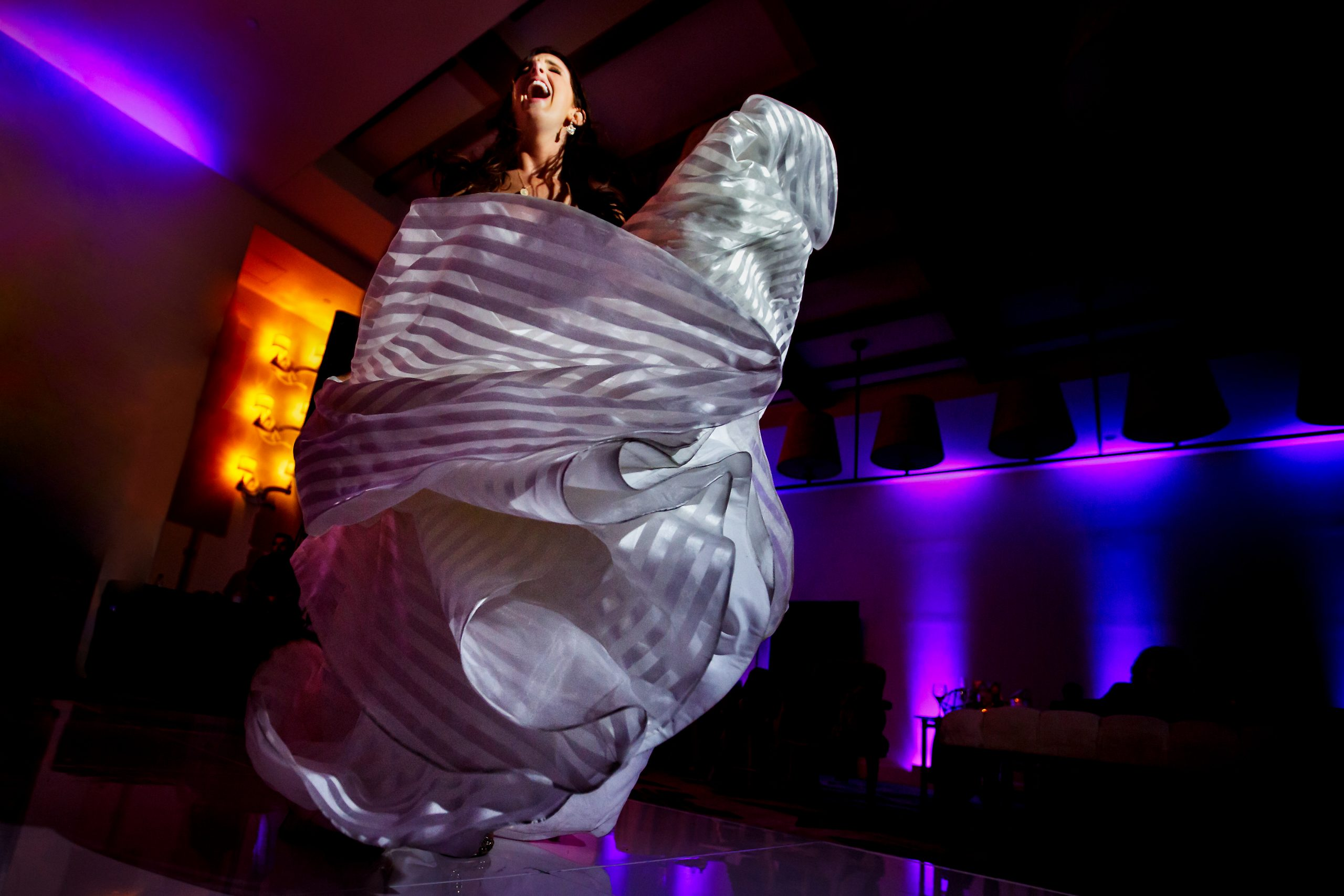 Bride's dress twirls as she dances