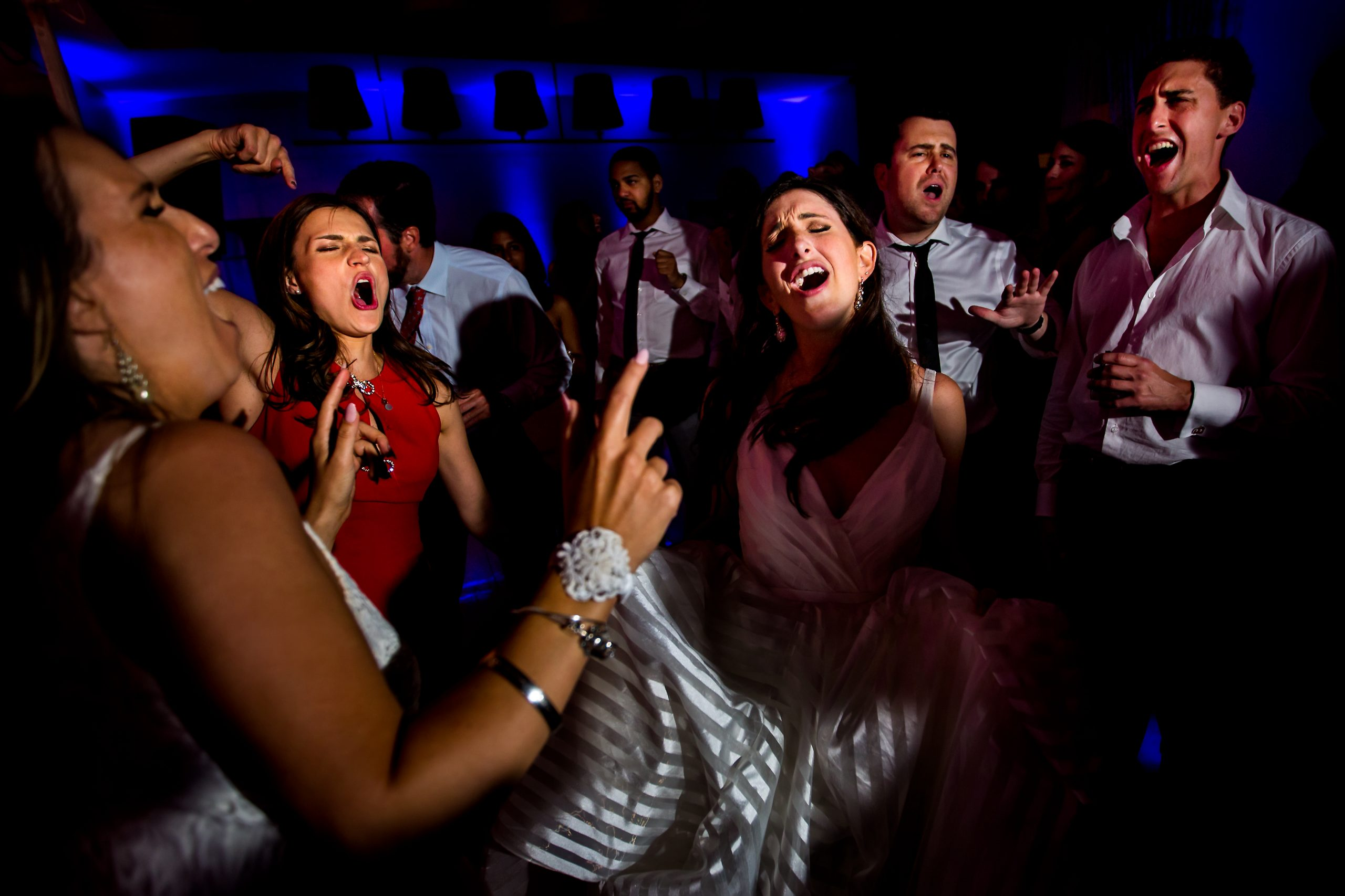 Bride dances and sings with guests