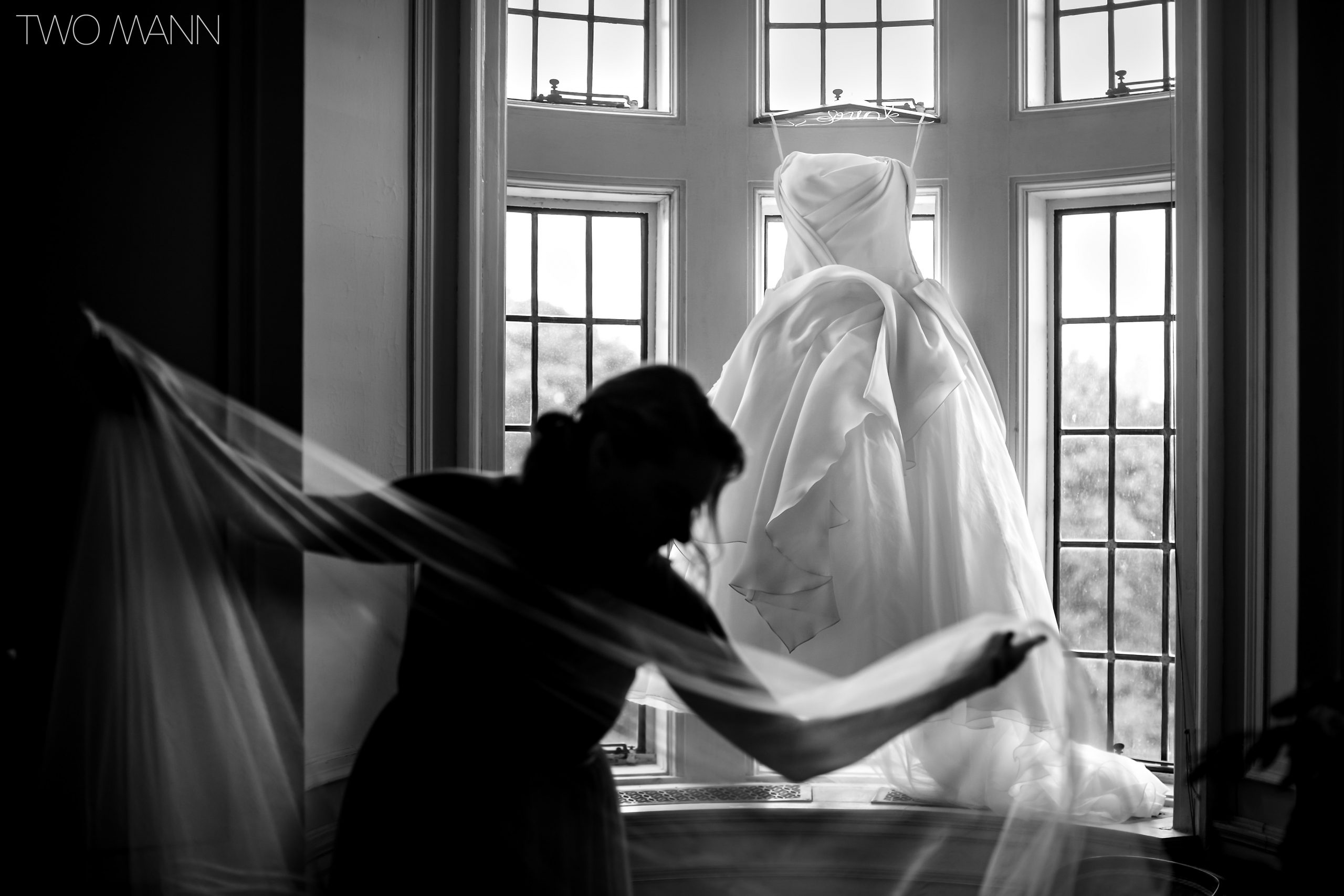 Mother of bride adjusting wedding dress