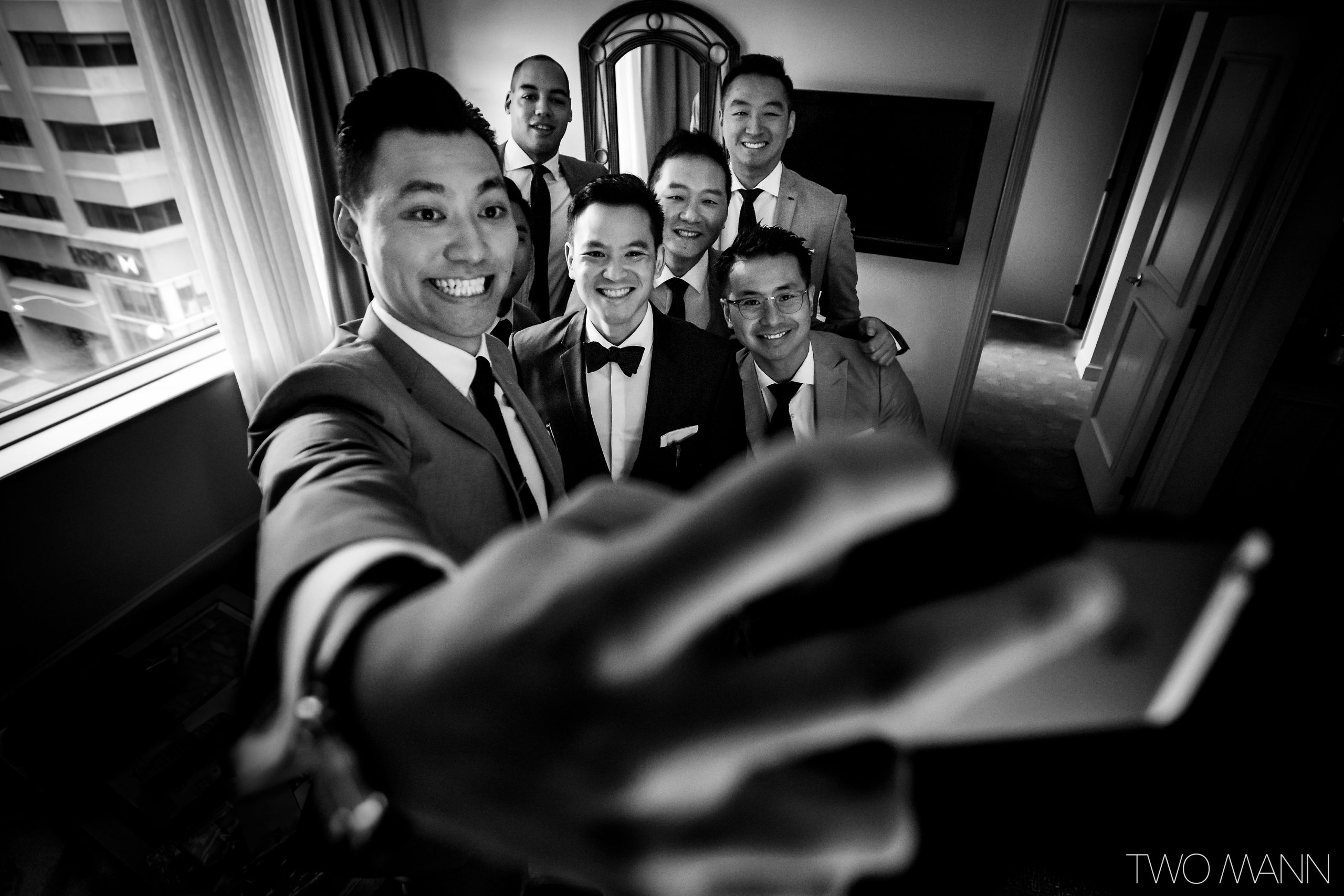 groomsman takes bridal party selfie with groom and groomsmen