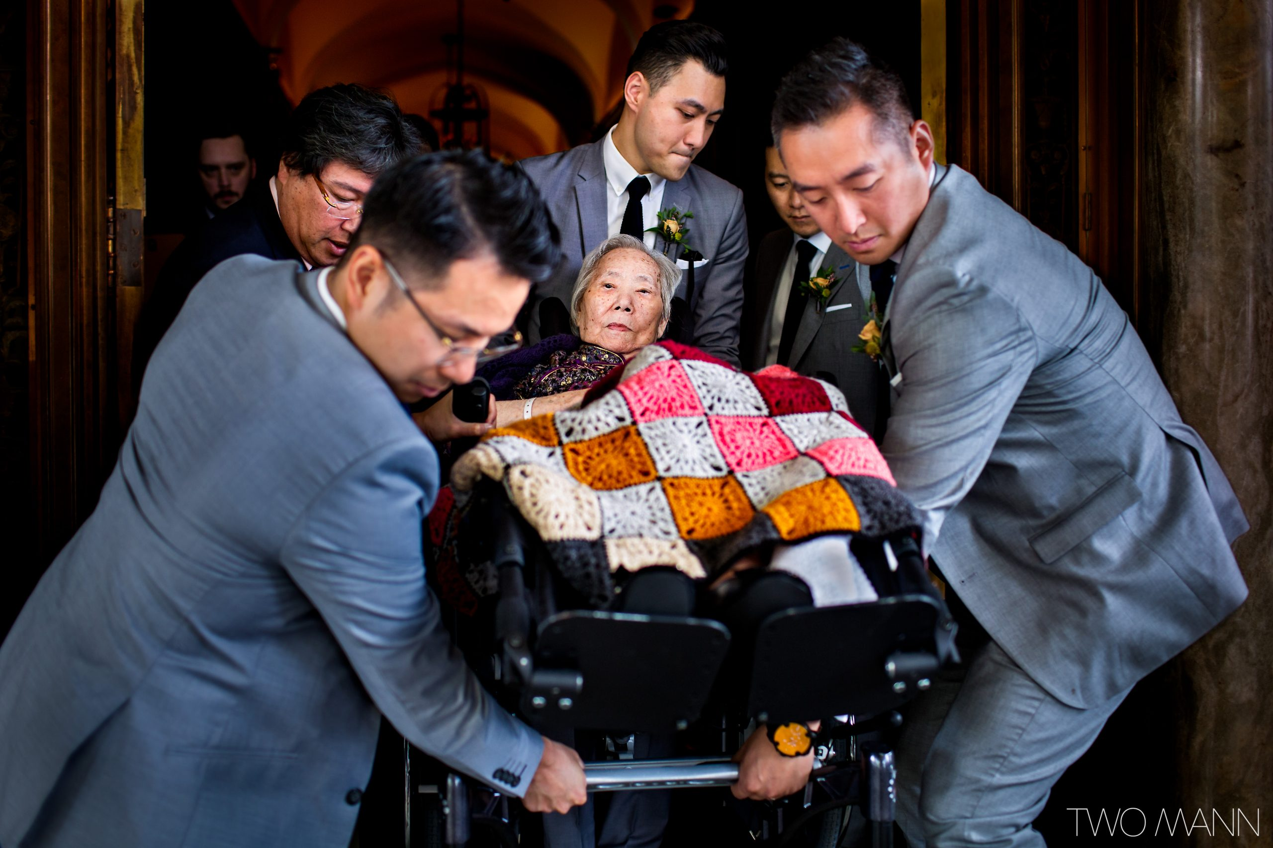 grandmother arriving in wheelchair to chinese wedding ceremony