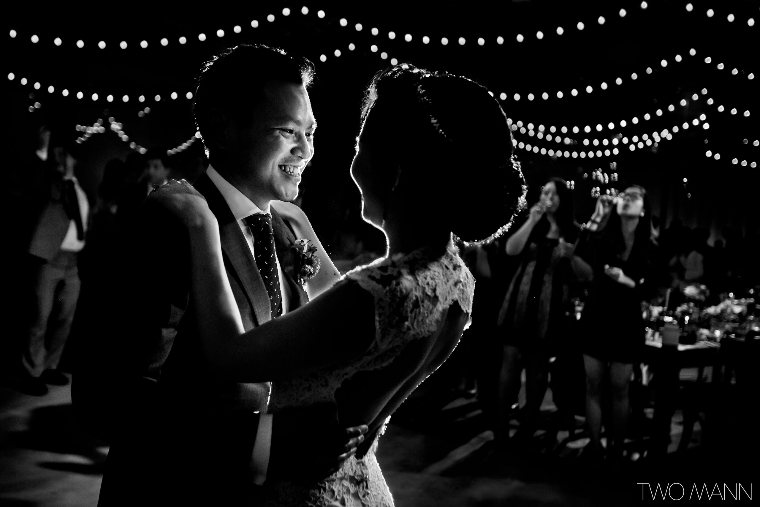 black and white bride and groom first dance backlight