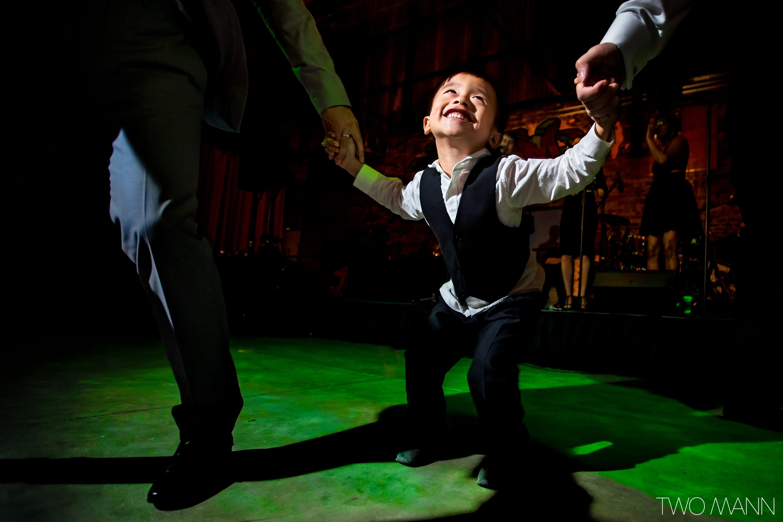 little boy dancing at wedding reception