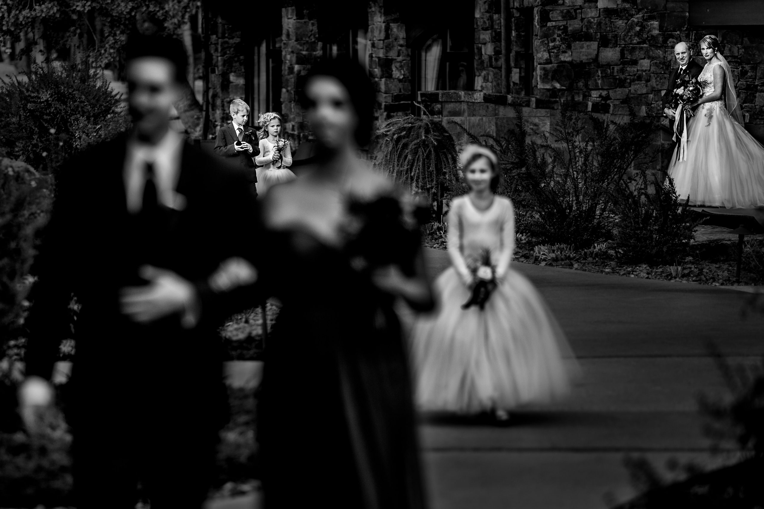 Bride, father-of-the-bride, ring bearer and flower girls at wedding processional