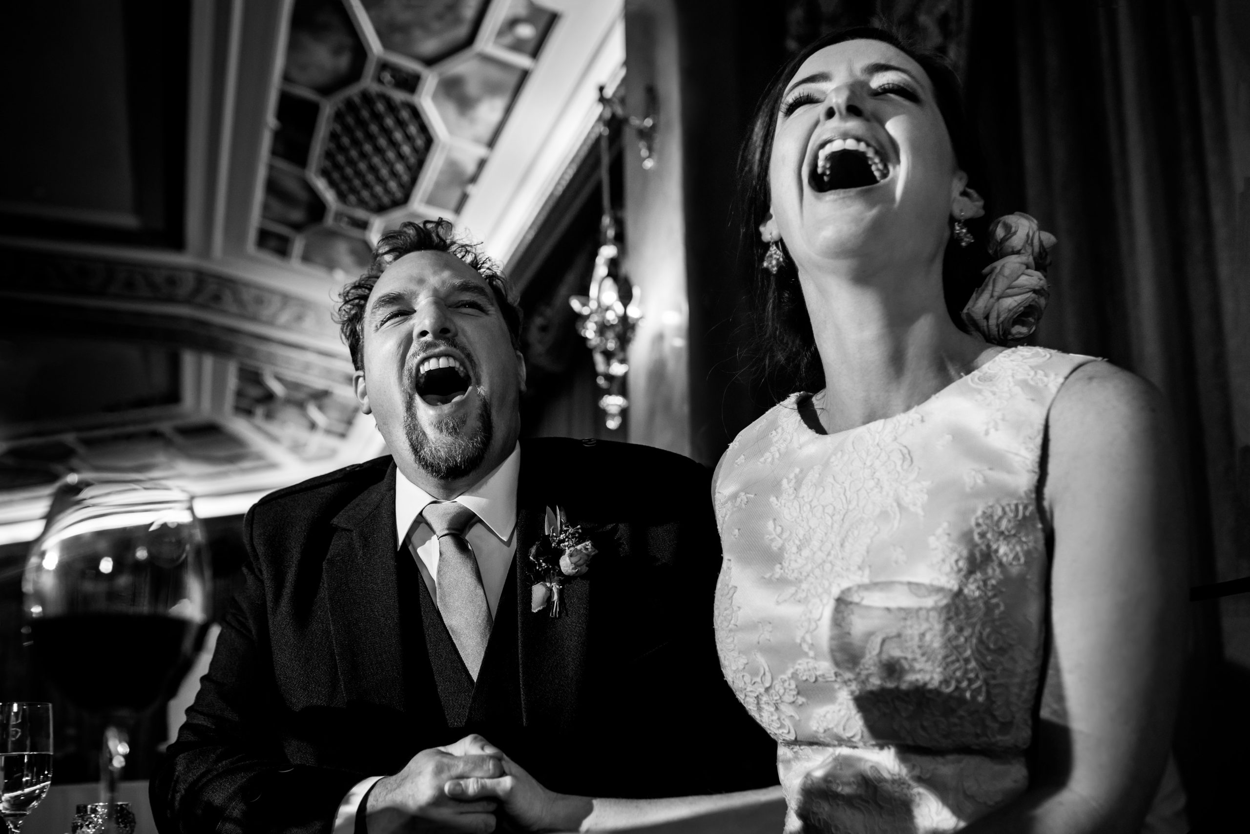 Laughing bride and groom at wedding reception