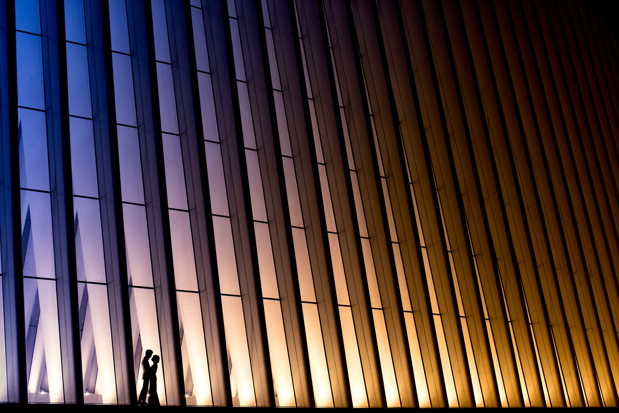 Silhouette of bride and groom in front of architecture in Brooklyn, New York