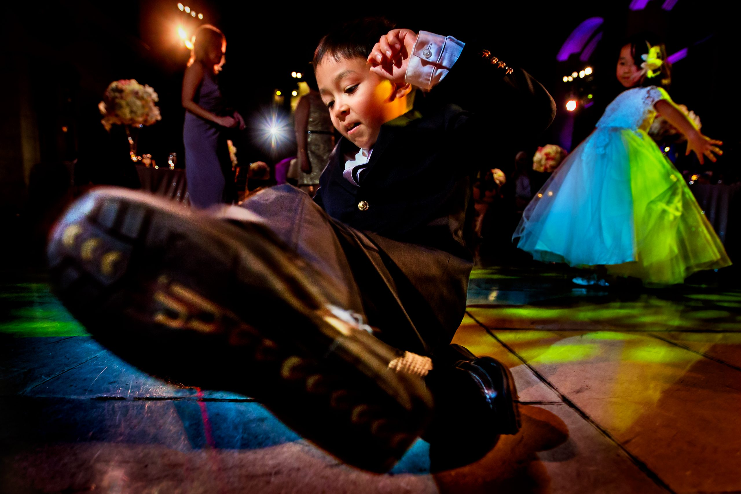 Young boy breakdancing on dance floor at wedding party