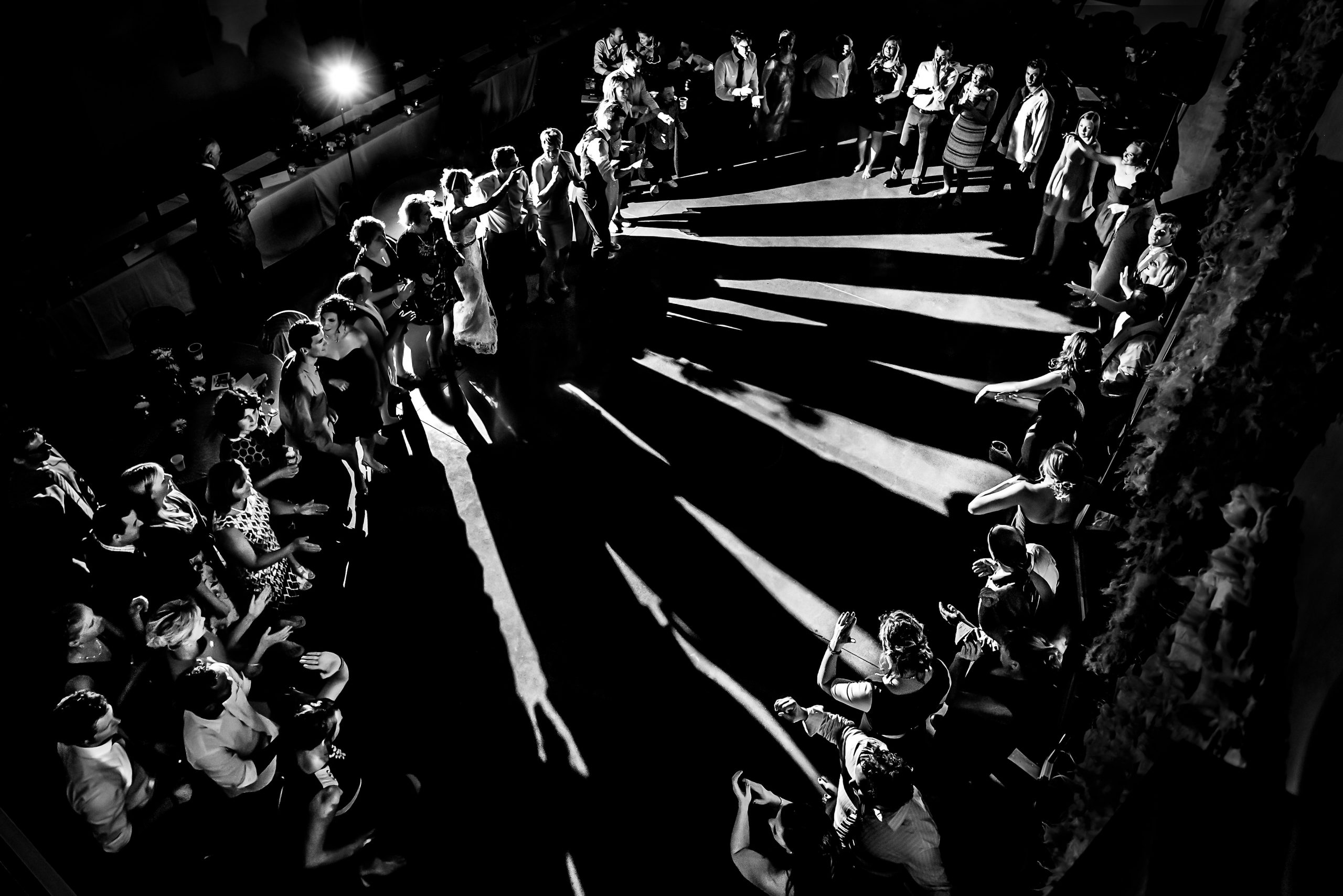 Long shadows are shown as partygoers gather in a circle