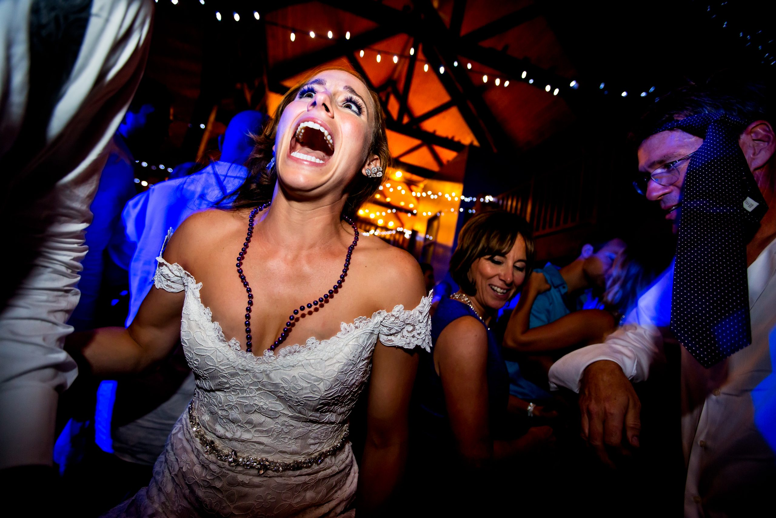 A bride dances excitedly on the dance floor