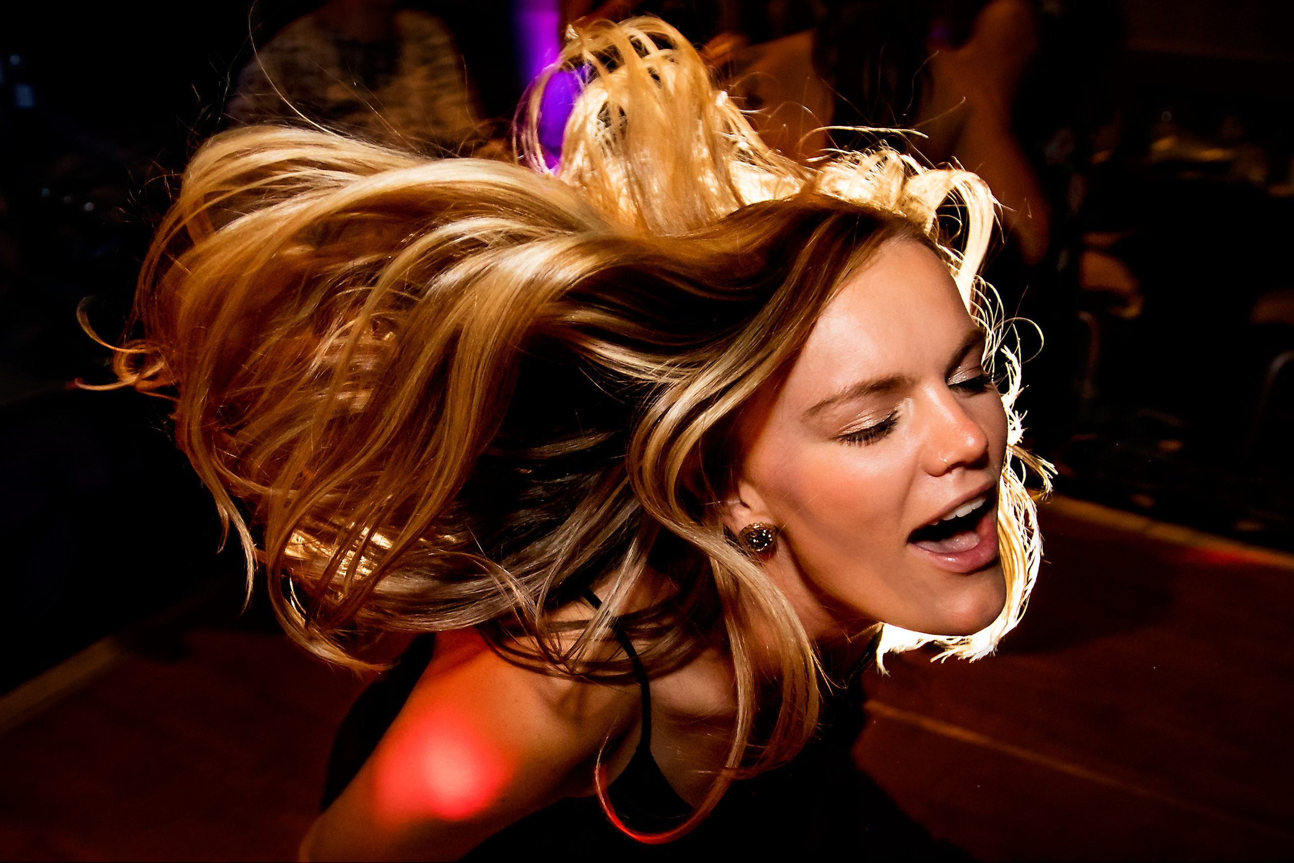 Woman's hair flows freely on the dance floor