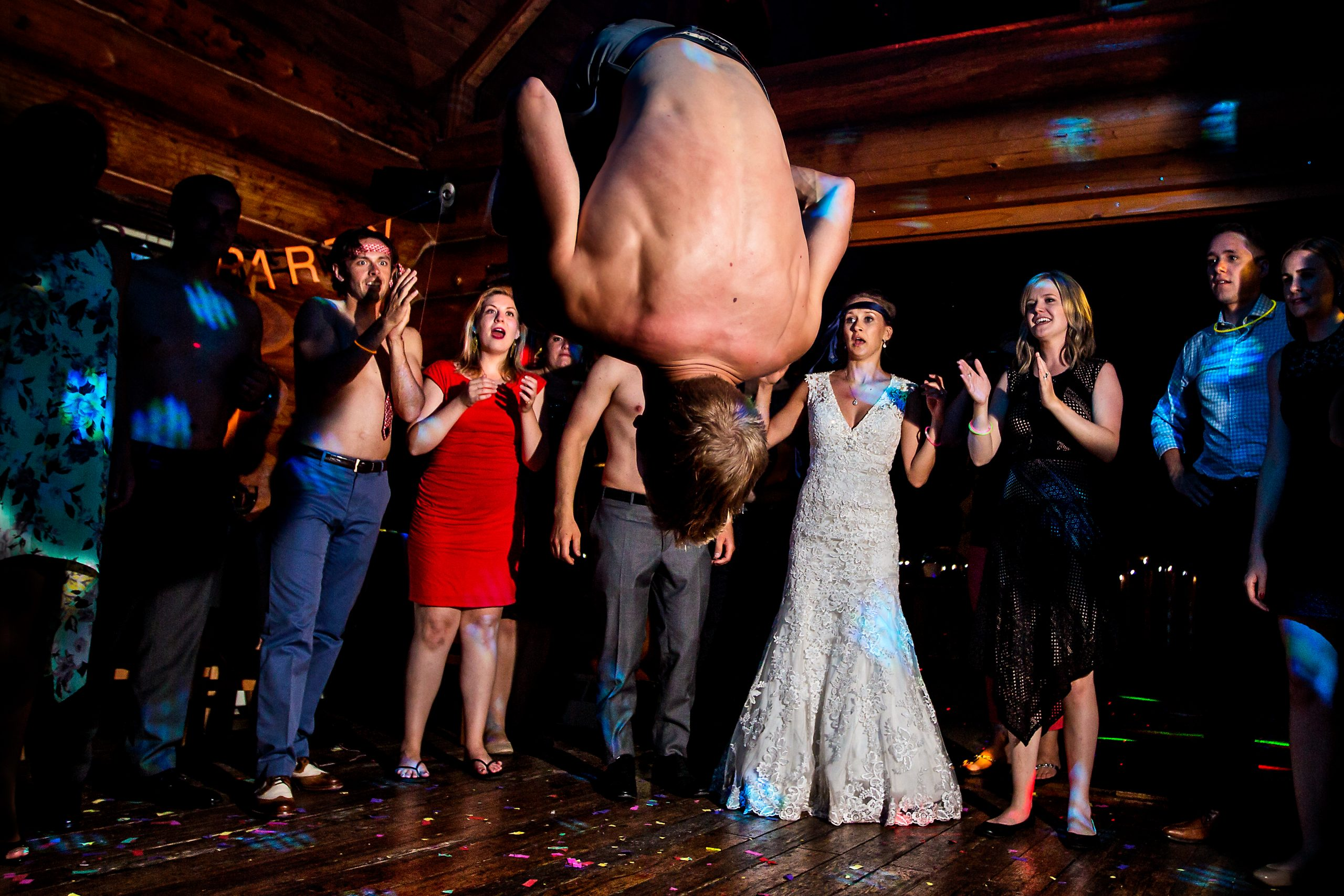 Man performs front flip in front of impressed guests