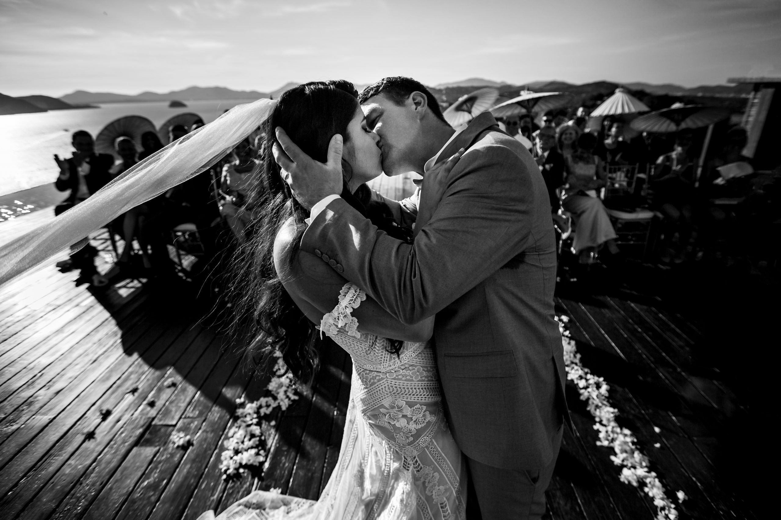 Groom kisses bride during the wedding ceremony