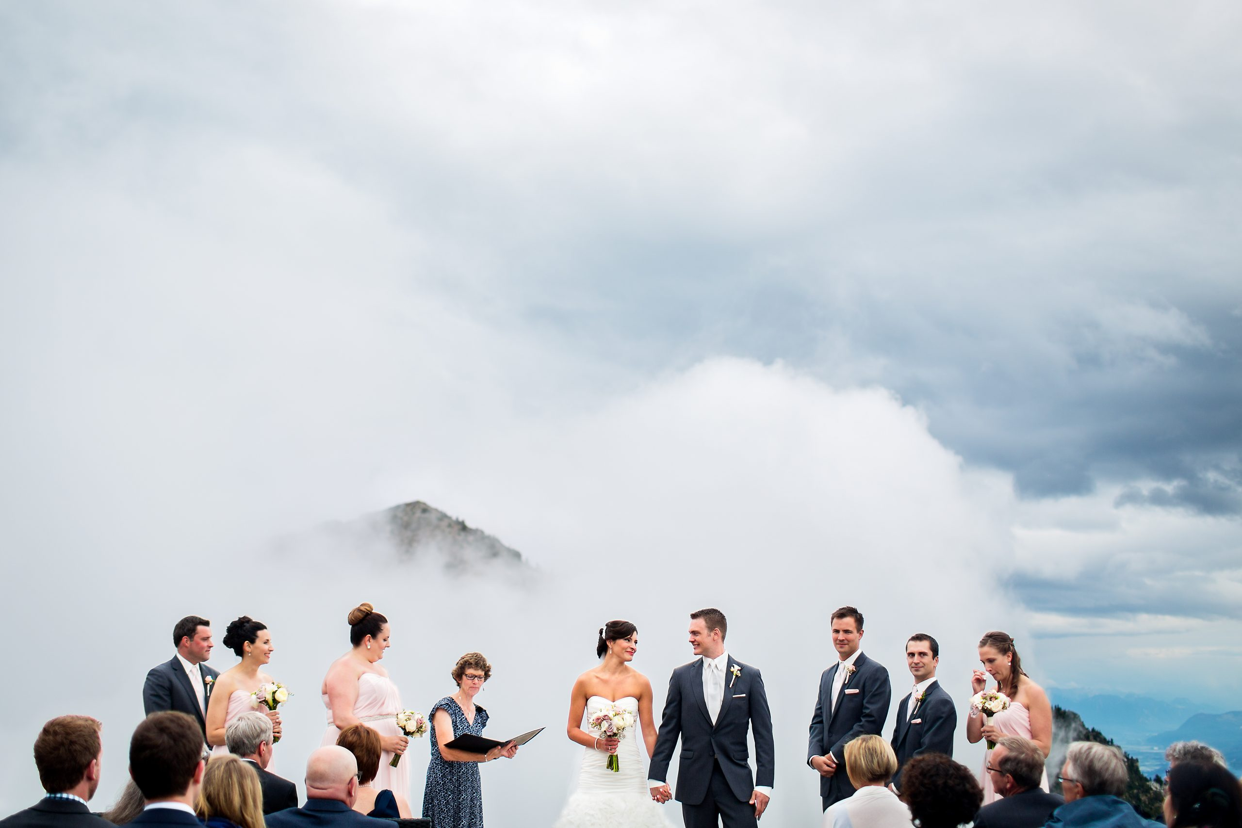 Wedding ceremony on misty mountaintop