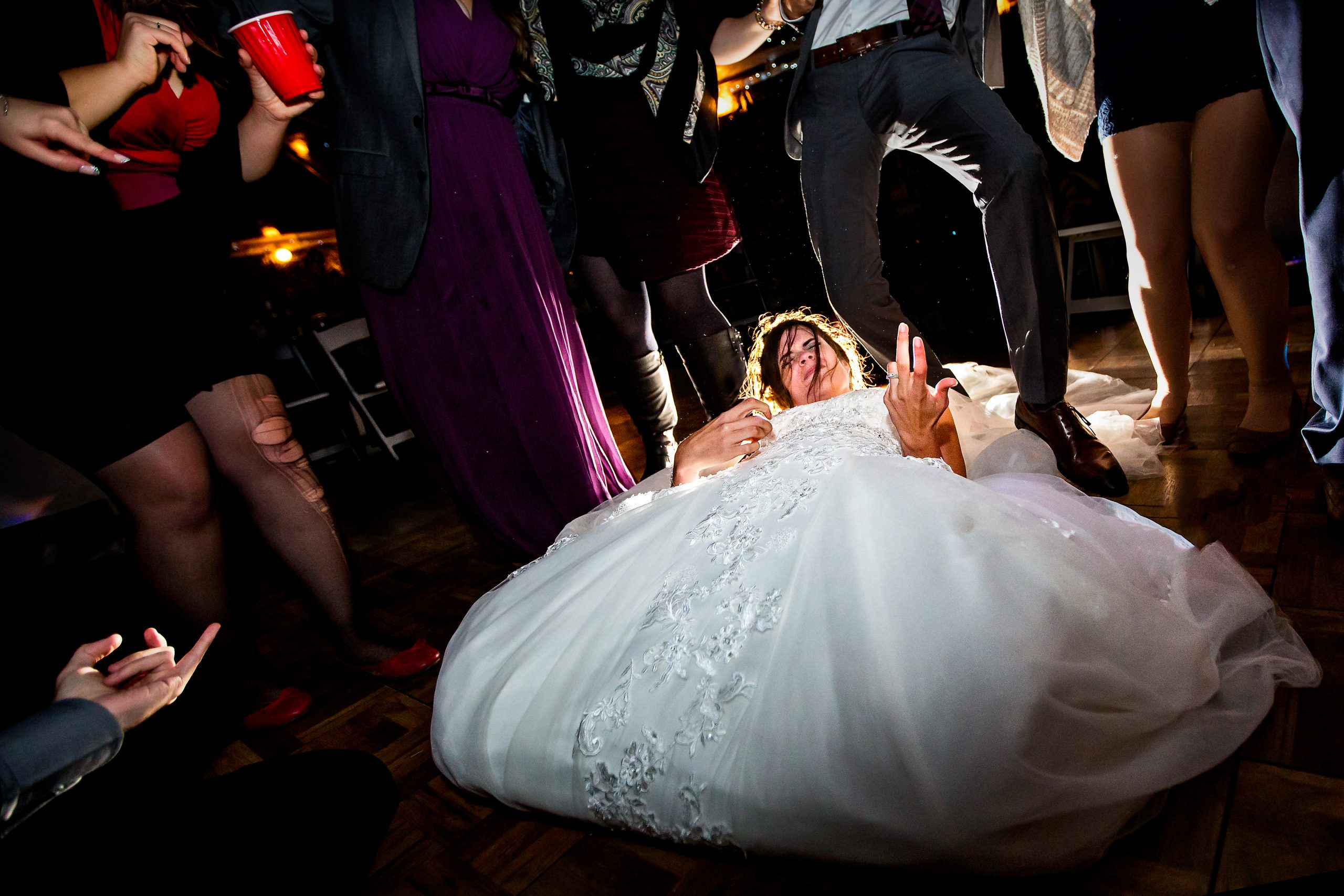 Bride plays air guitar on the party floor