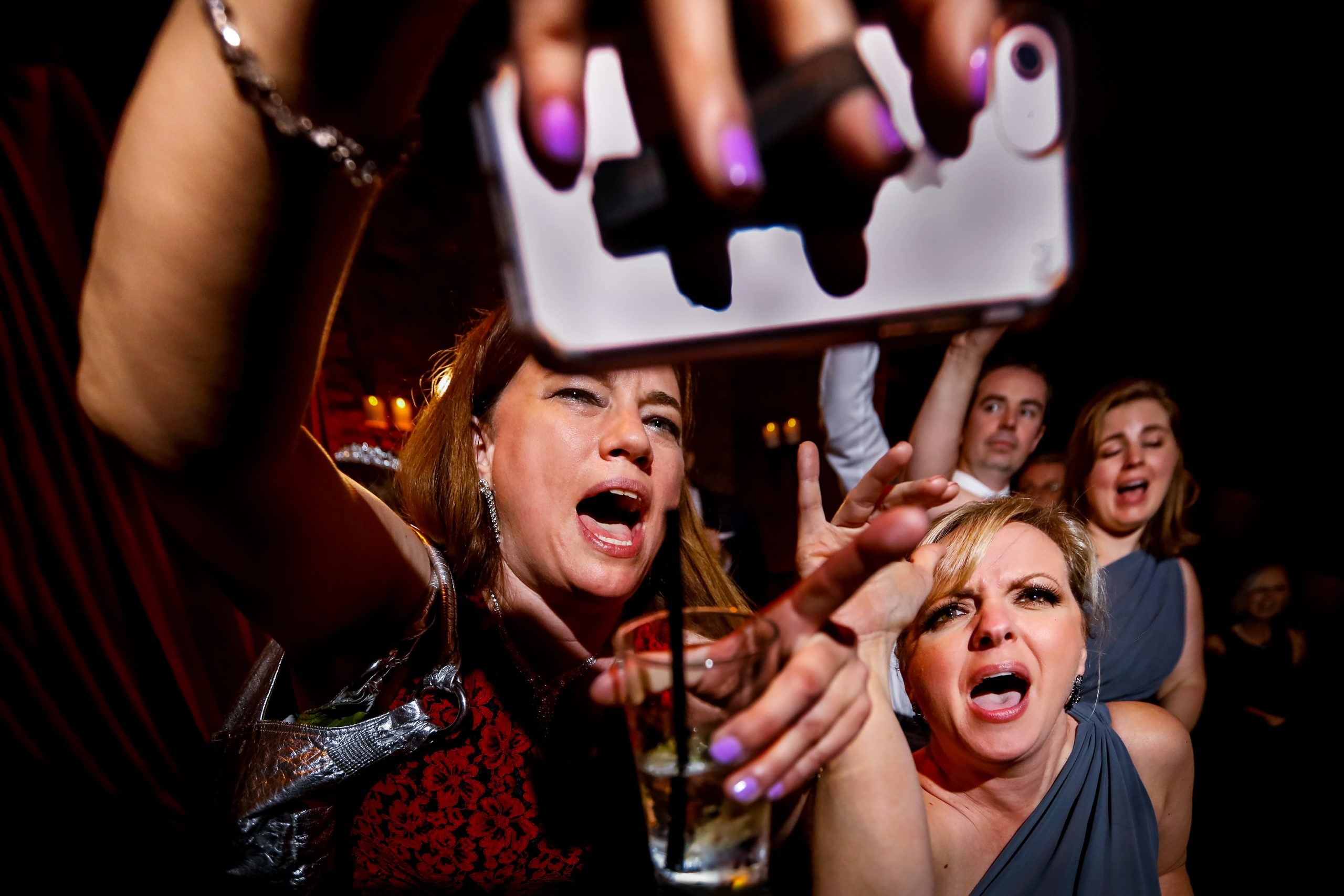 Wedding guests take a selfie while partying