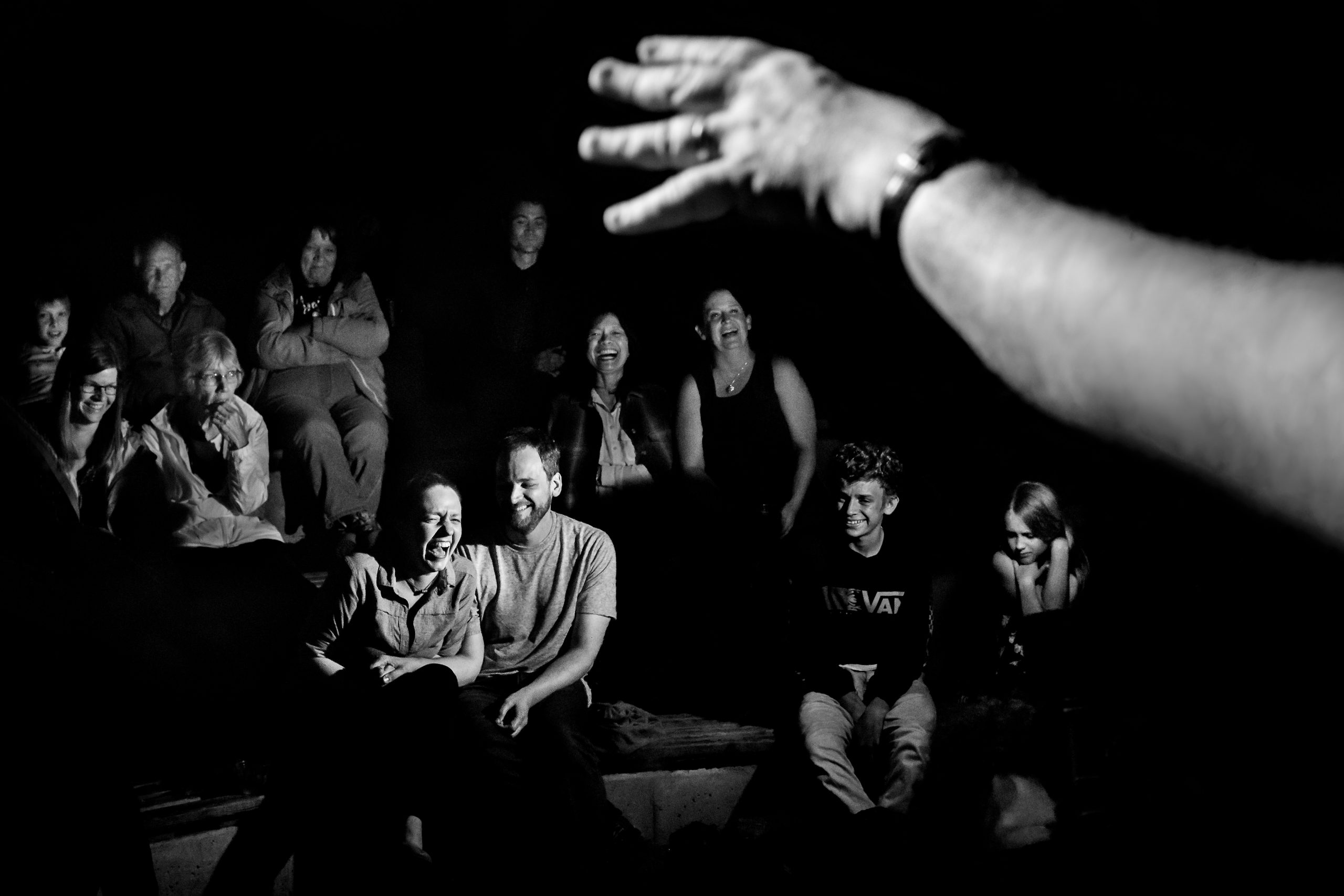 Audience laughs at ongoing performance