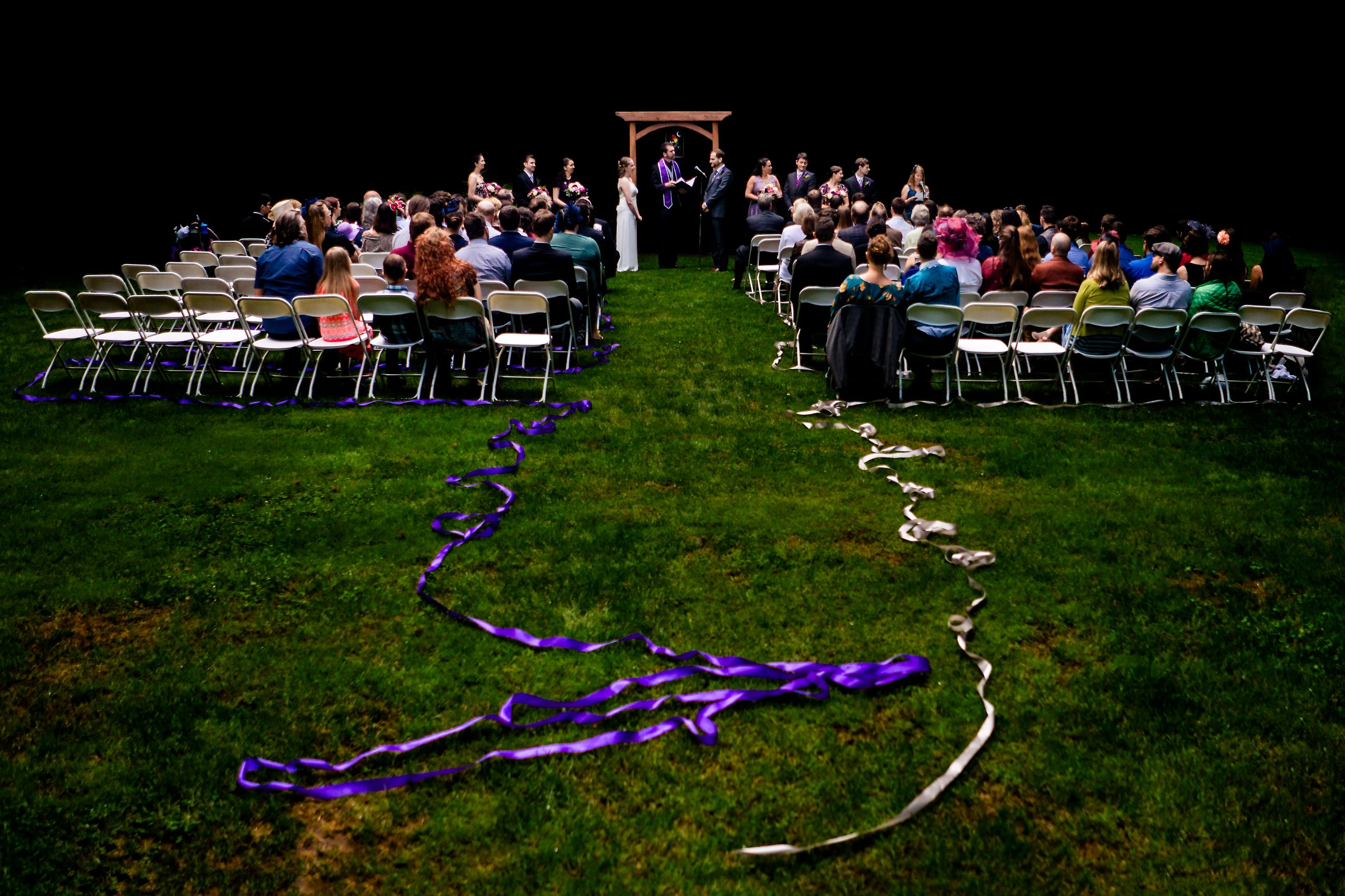 Wedding ceremony in progress on a green lawn