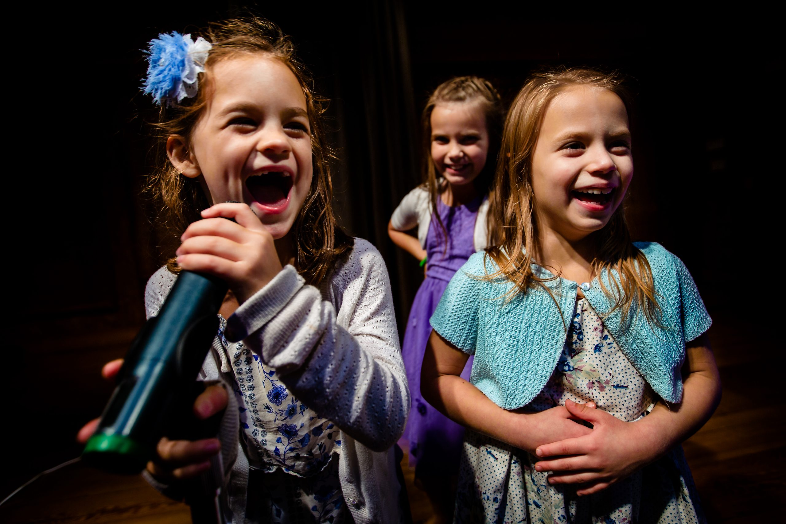 Three young girls perform
