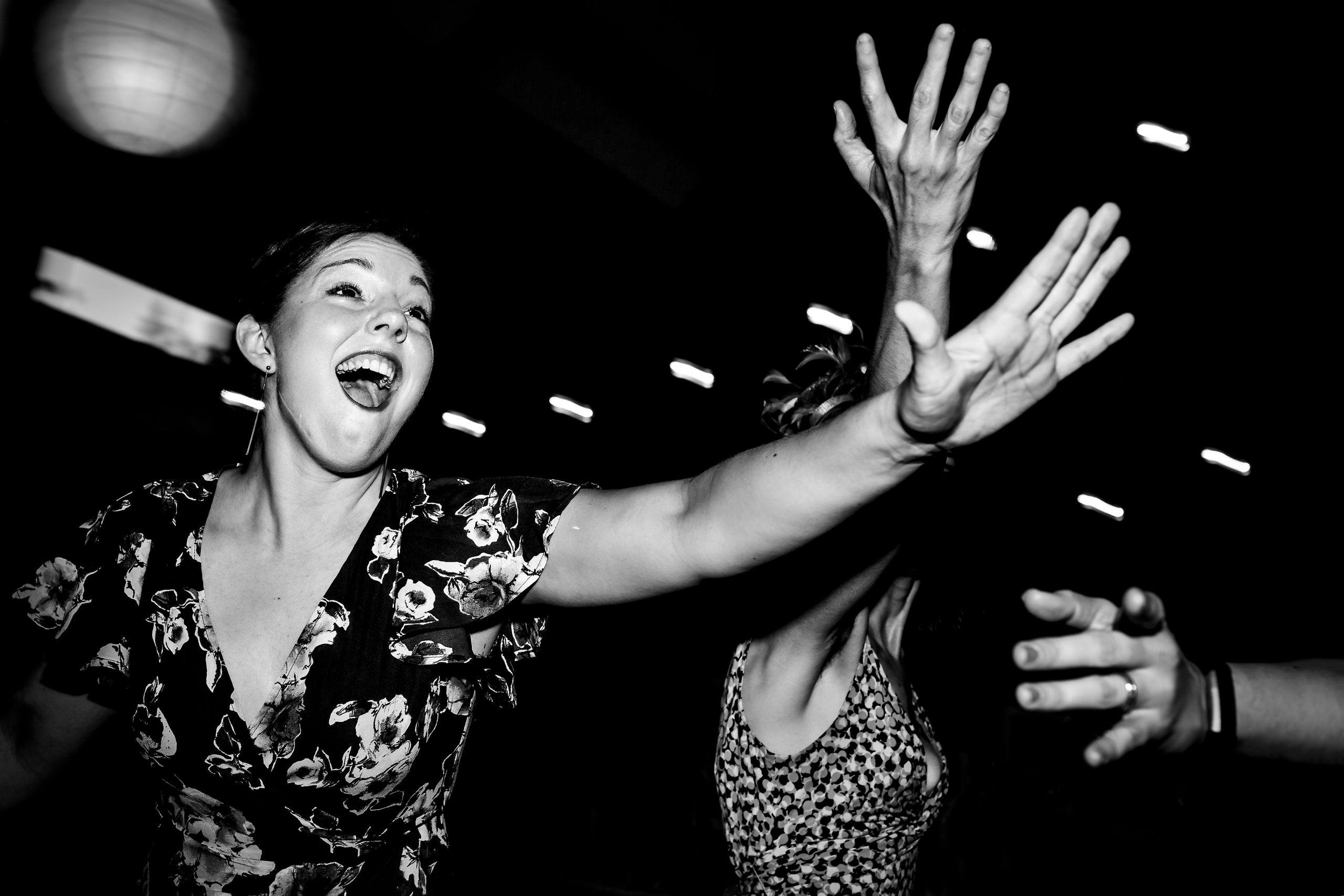 A woman dances with other people