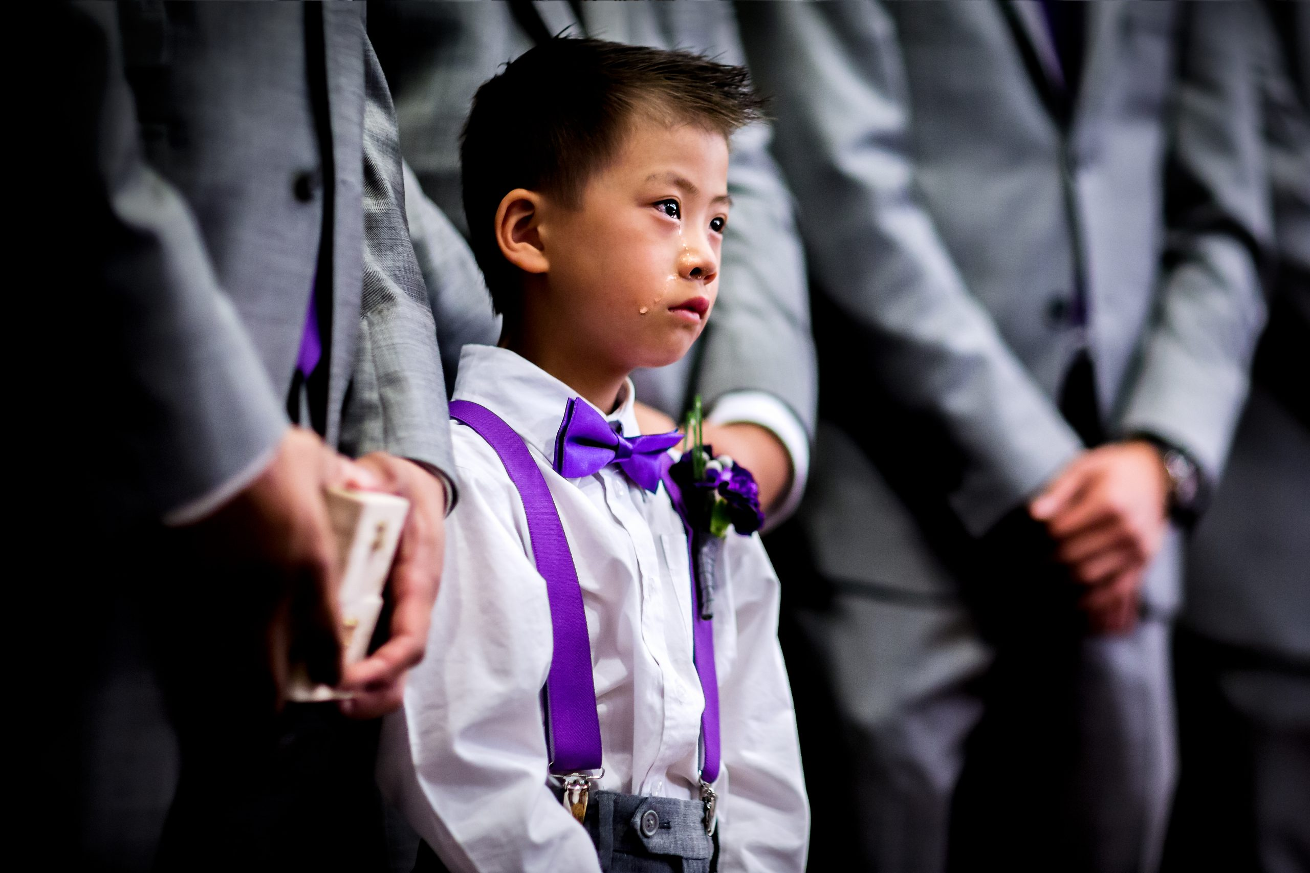 Young boy in tears at wedding ceremony