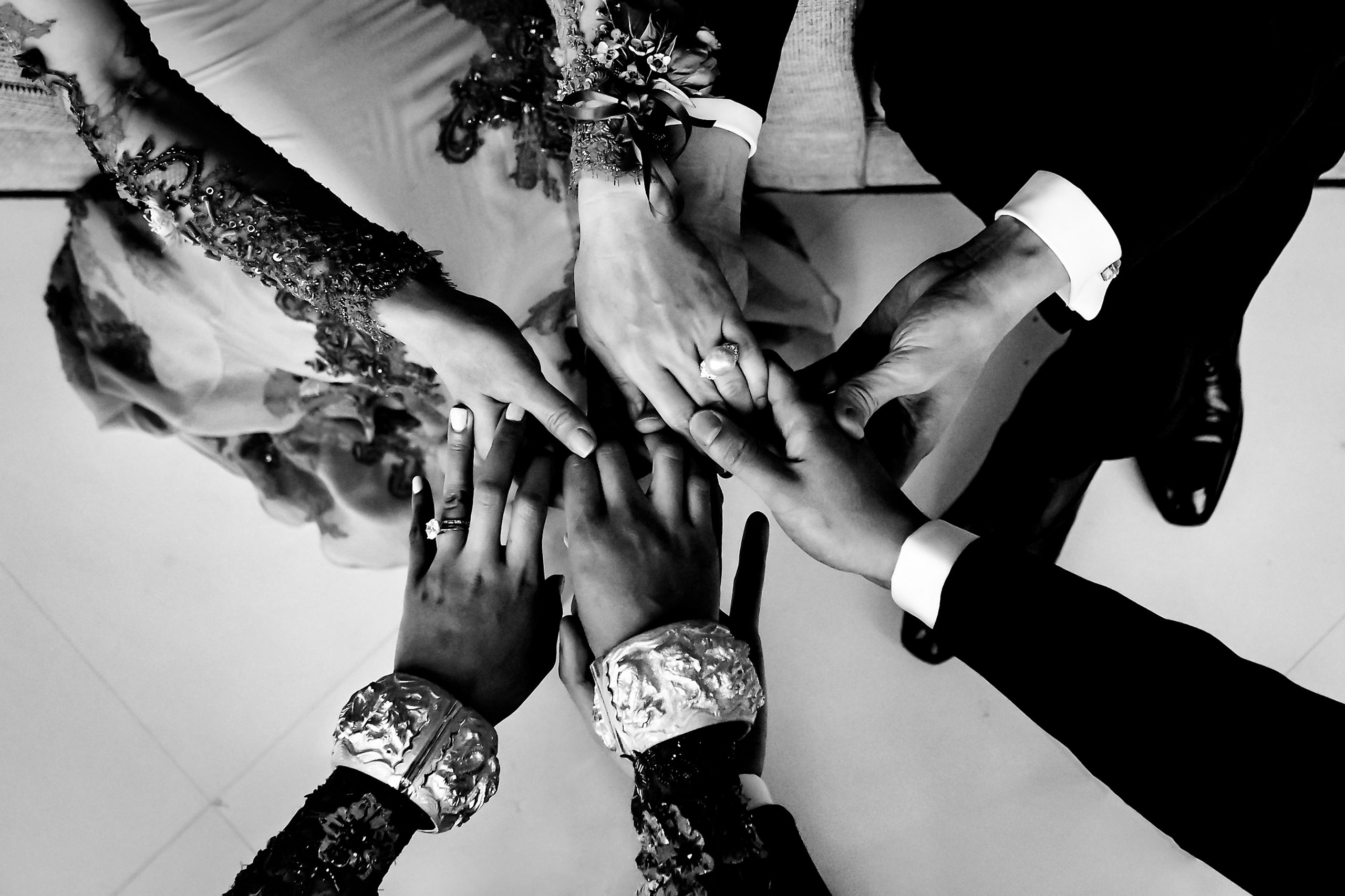 Bride and groom hold her parents hands
