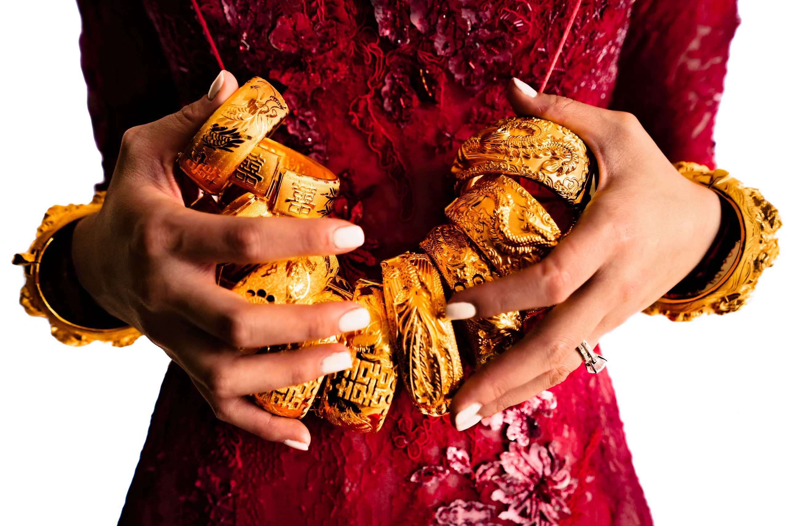Bride holds a number of golden bracelets