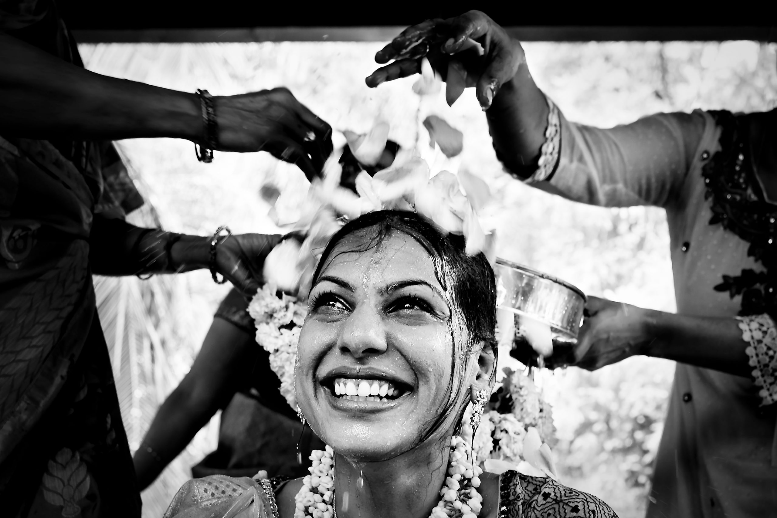 Throwing flower petals on the head of an Indian bride