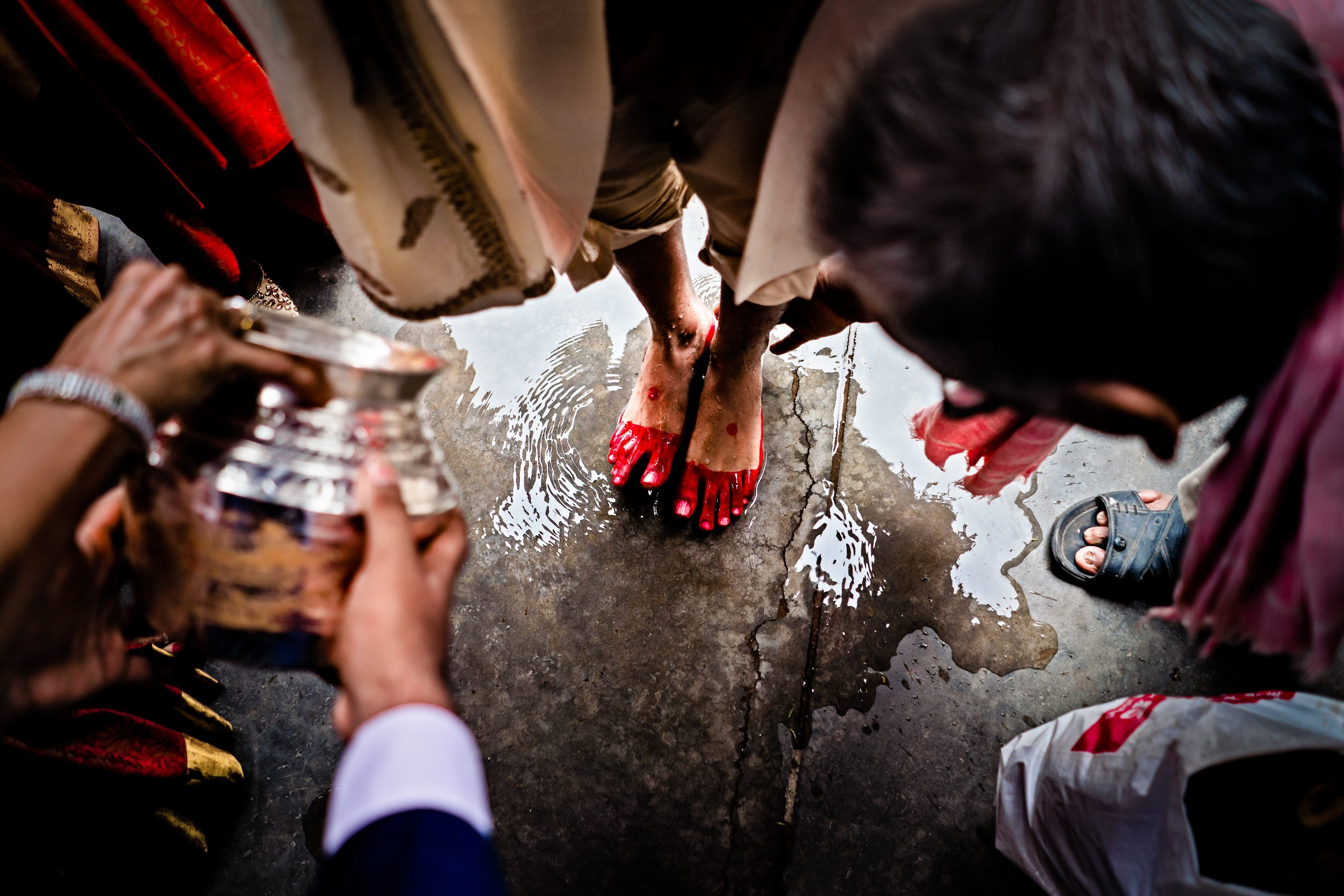 Indian wedding tradition of washing the feet of the groom
