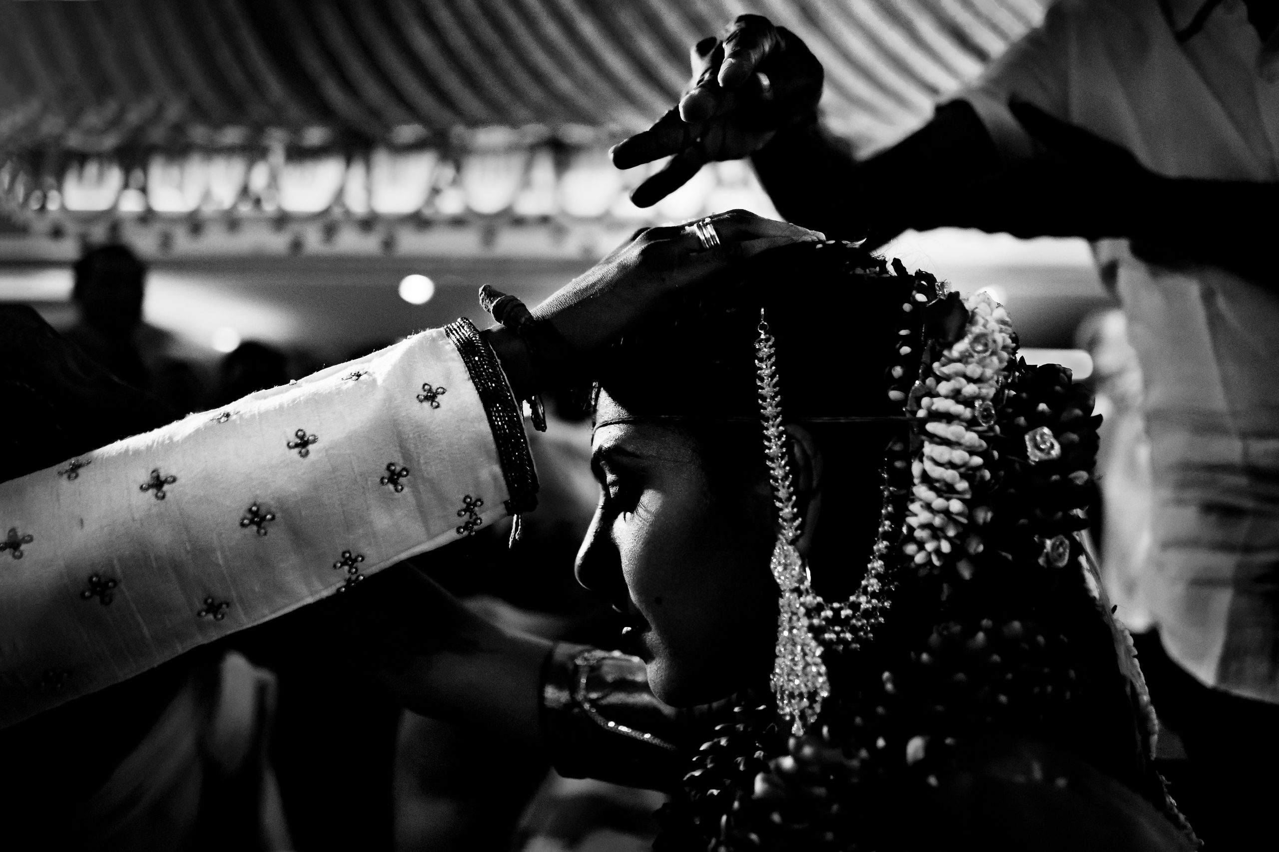 Groom touches the head of the bride during Indian wedding ceremony
