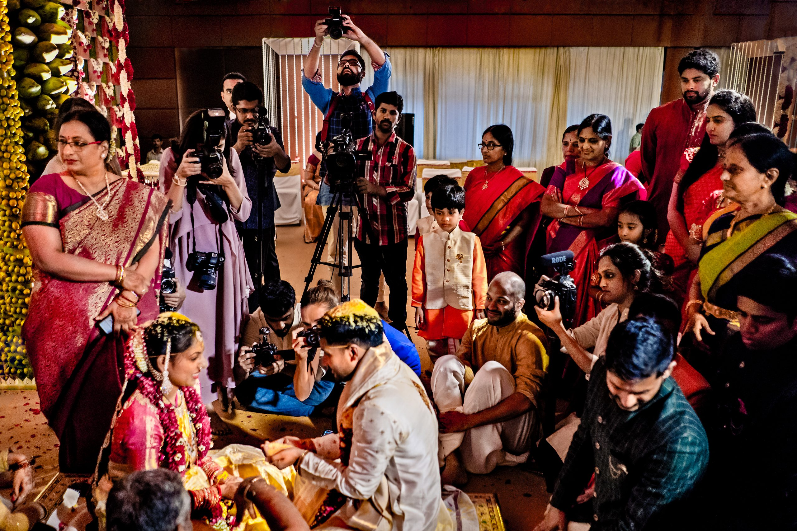 Friends and family with photographer photography Indian wedding ceremony