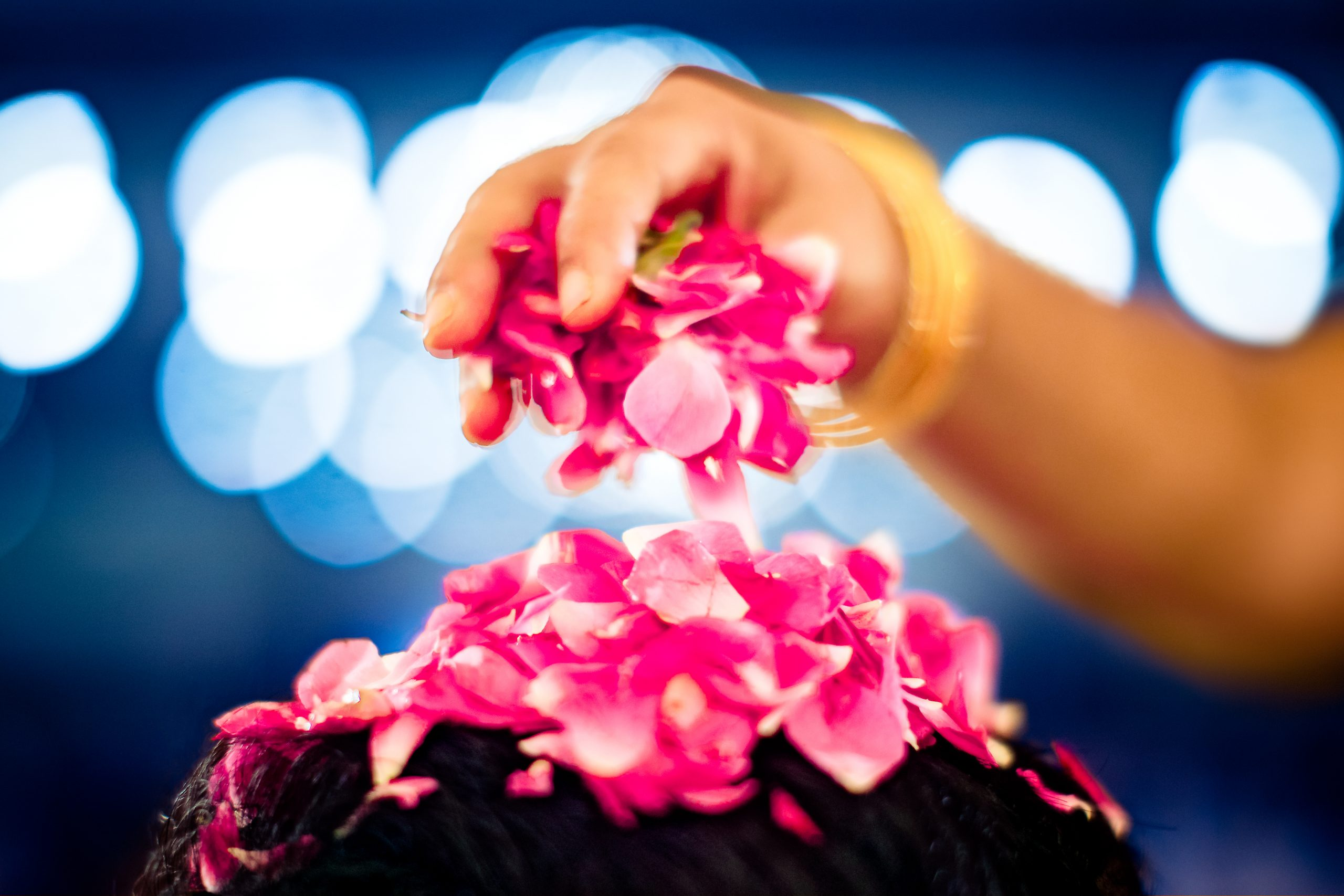 Placing flower petals on groom's head