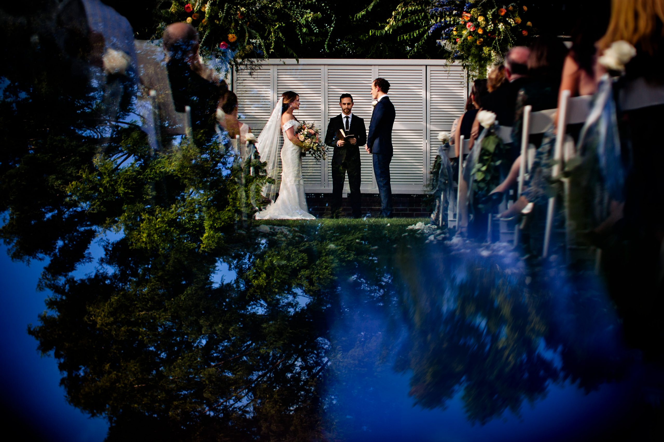 An outdoor wedding ceremony on a day with bright skies
