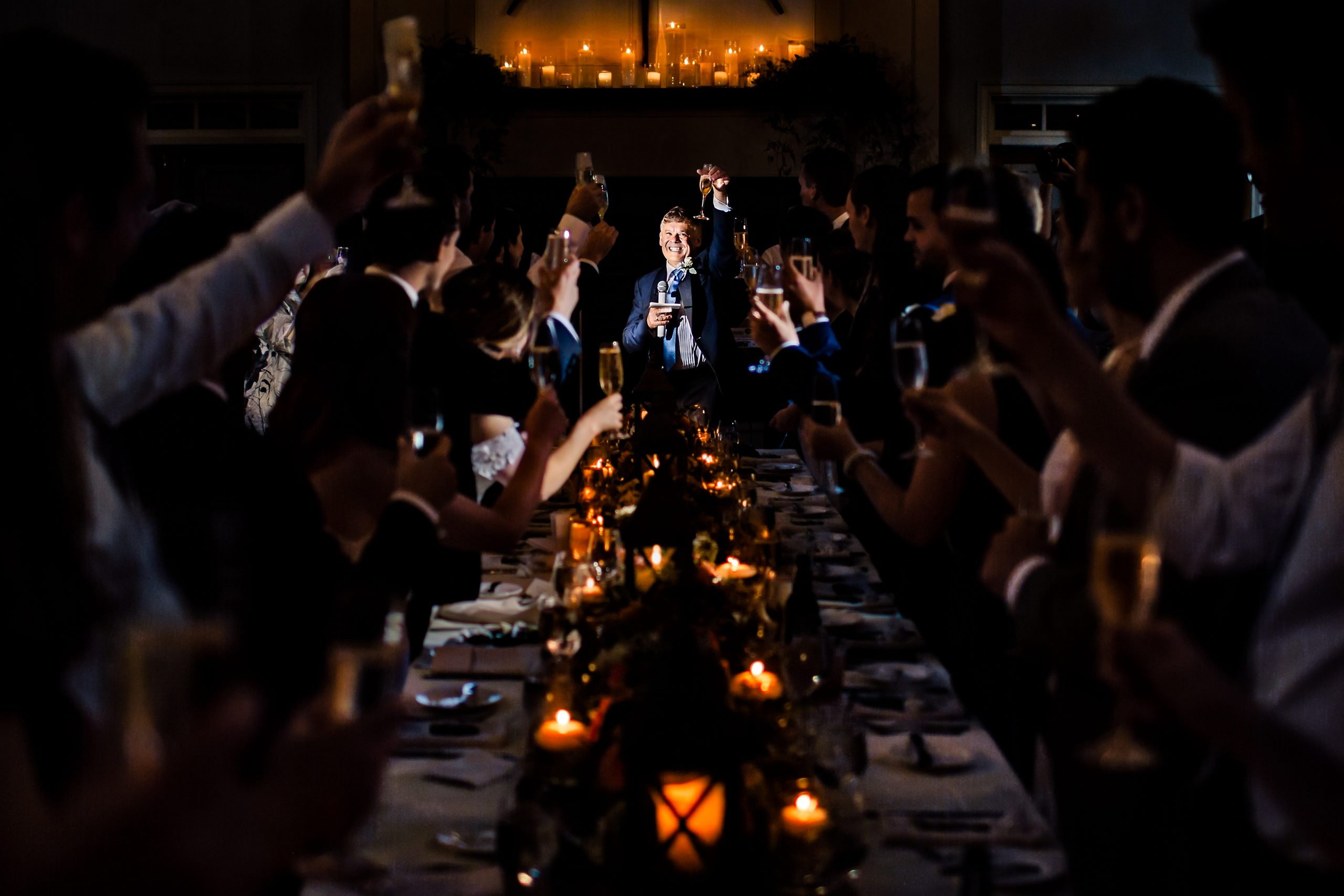 The bride's father raises a glass at the wedding banquet