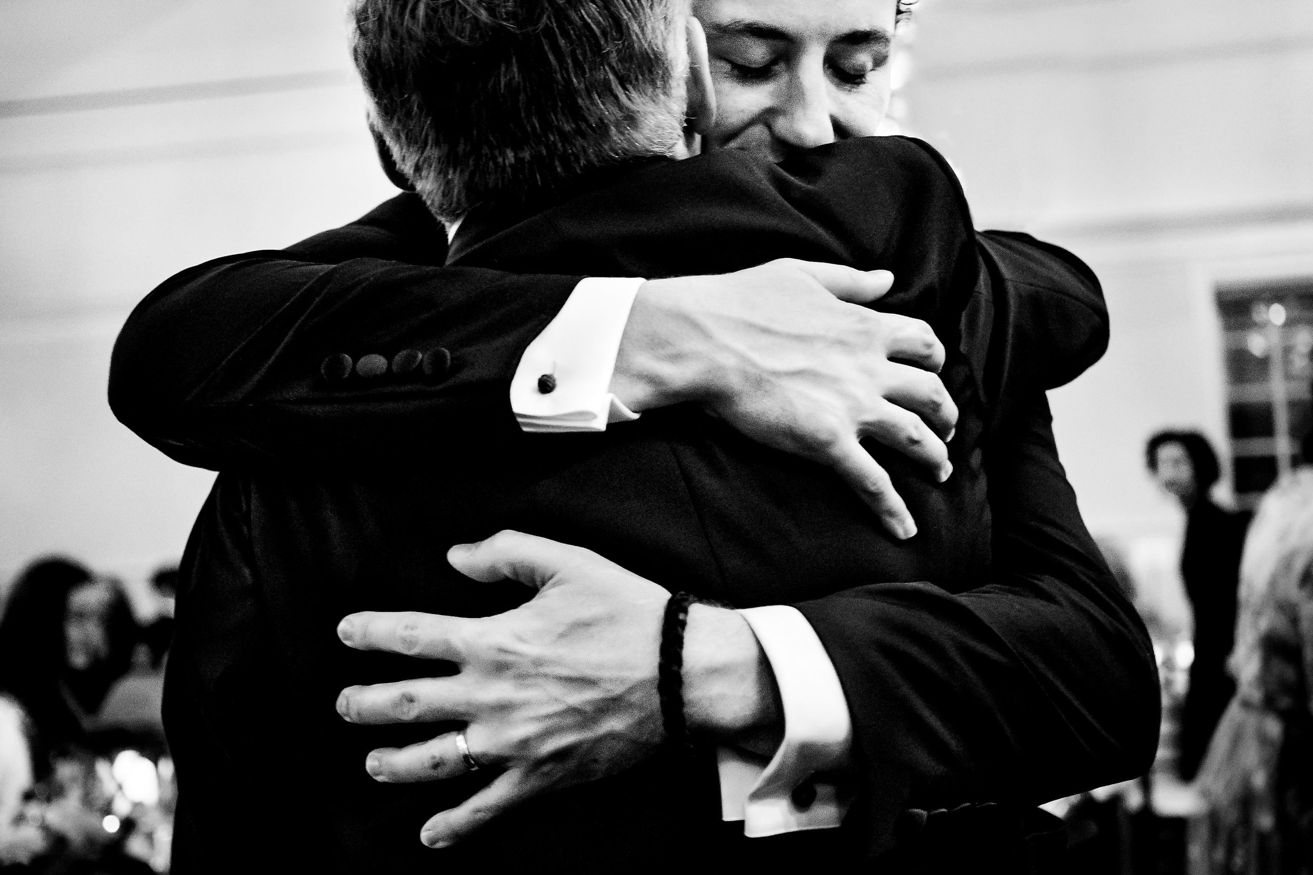 Groom hugs the bride's father