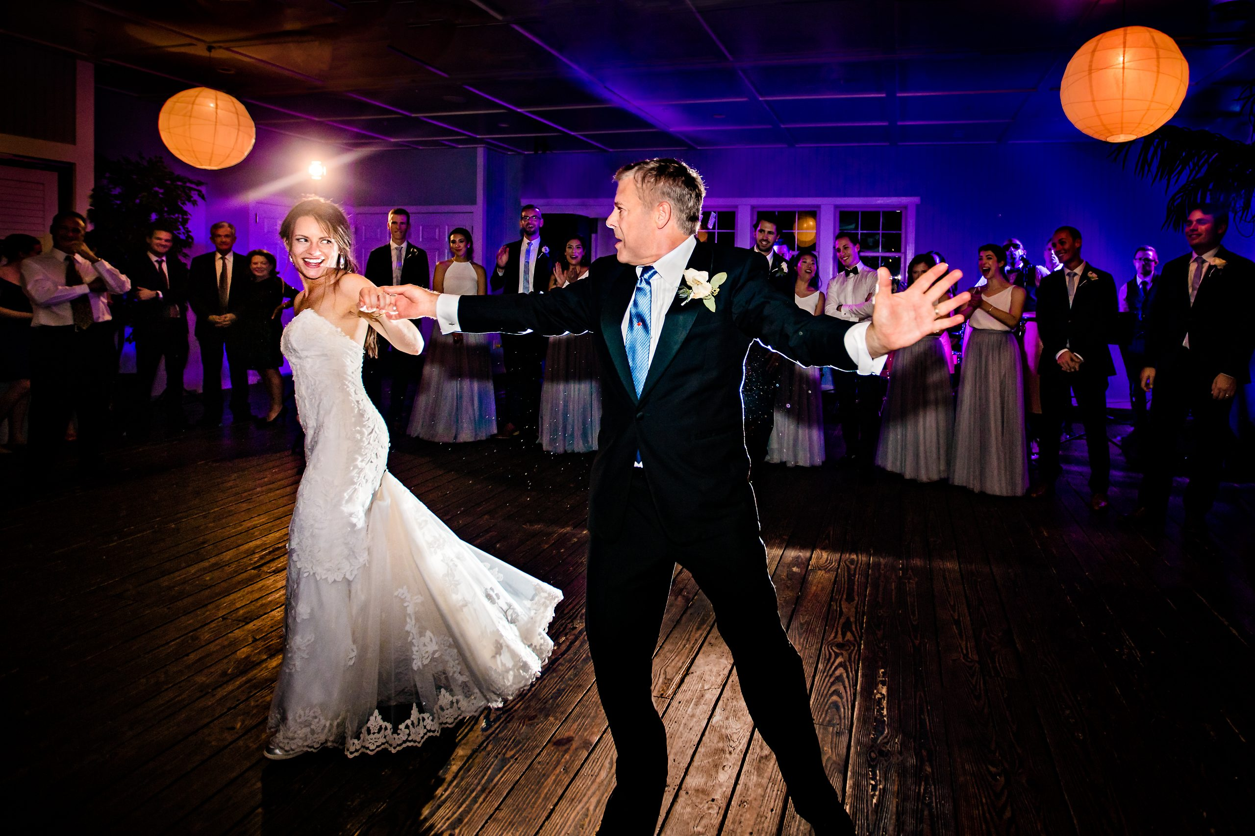 Bride and her father share a dance at the wedding banquet